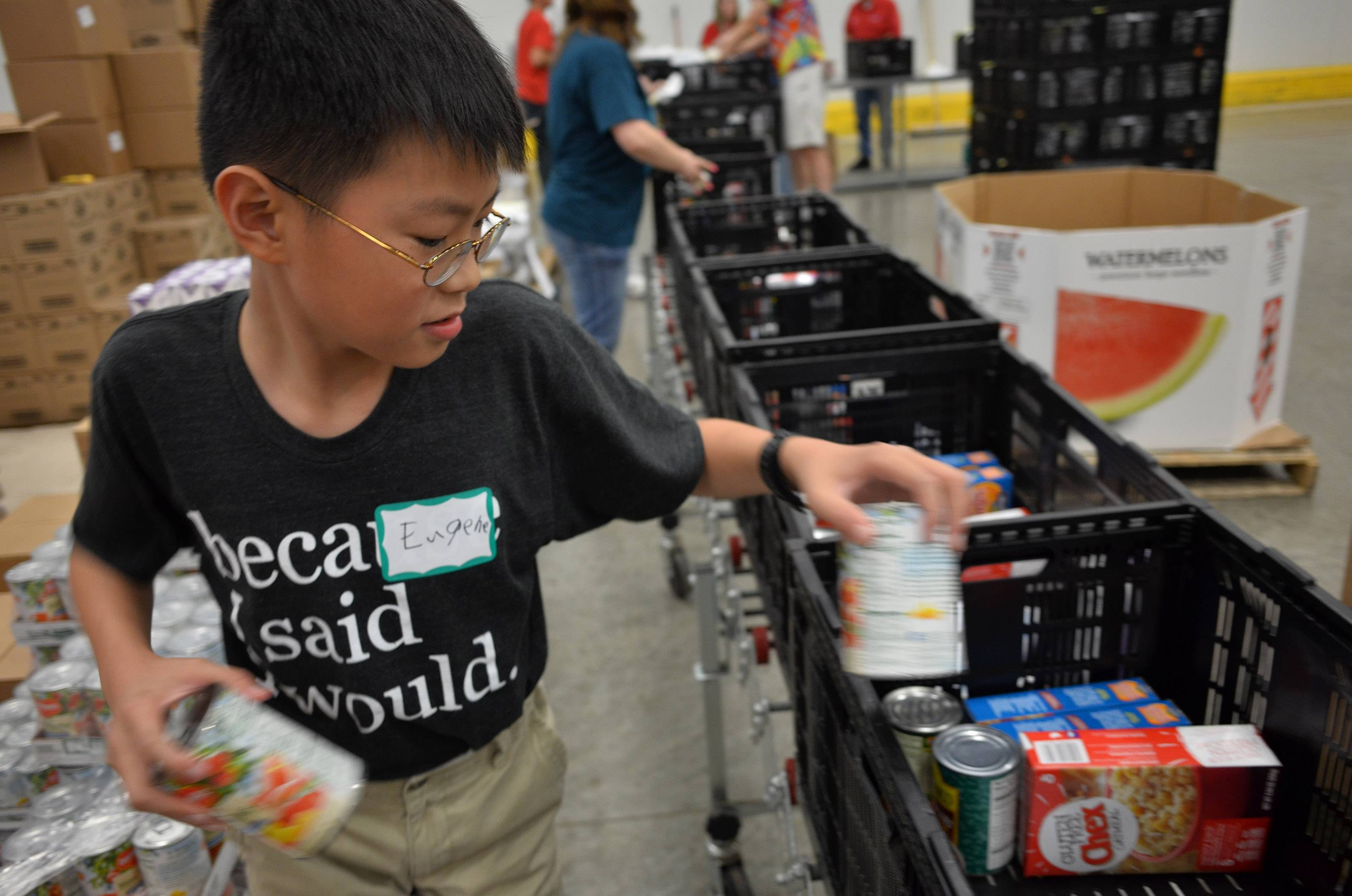 "Eugene Lim, age 11, received the Youth Volunteer of the Year award from the Northern Illinois Food Bank. Eugene, who volunteers once a week, says, ""I like that I'm making a difference in the community."""