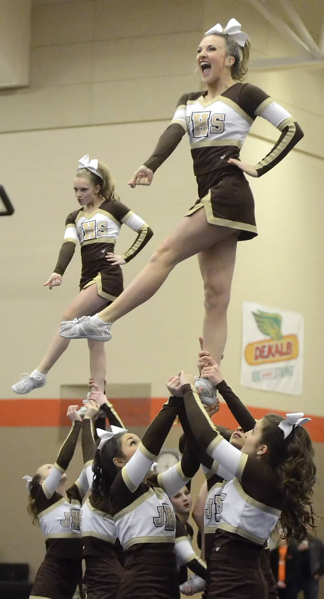 Jacobs High School cheerleaders perform at the DeKalb Sectional earlier this year. A controversy has been brewing over Community Unit District 300's enforcement of its dress code cracking down on students wearing cheerleading uniforms to class on game days.