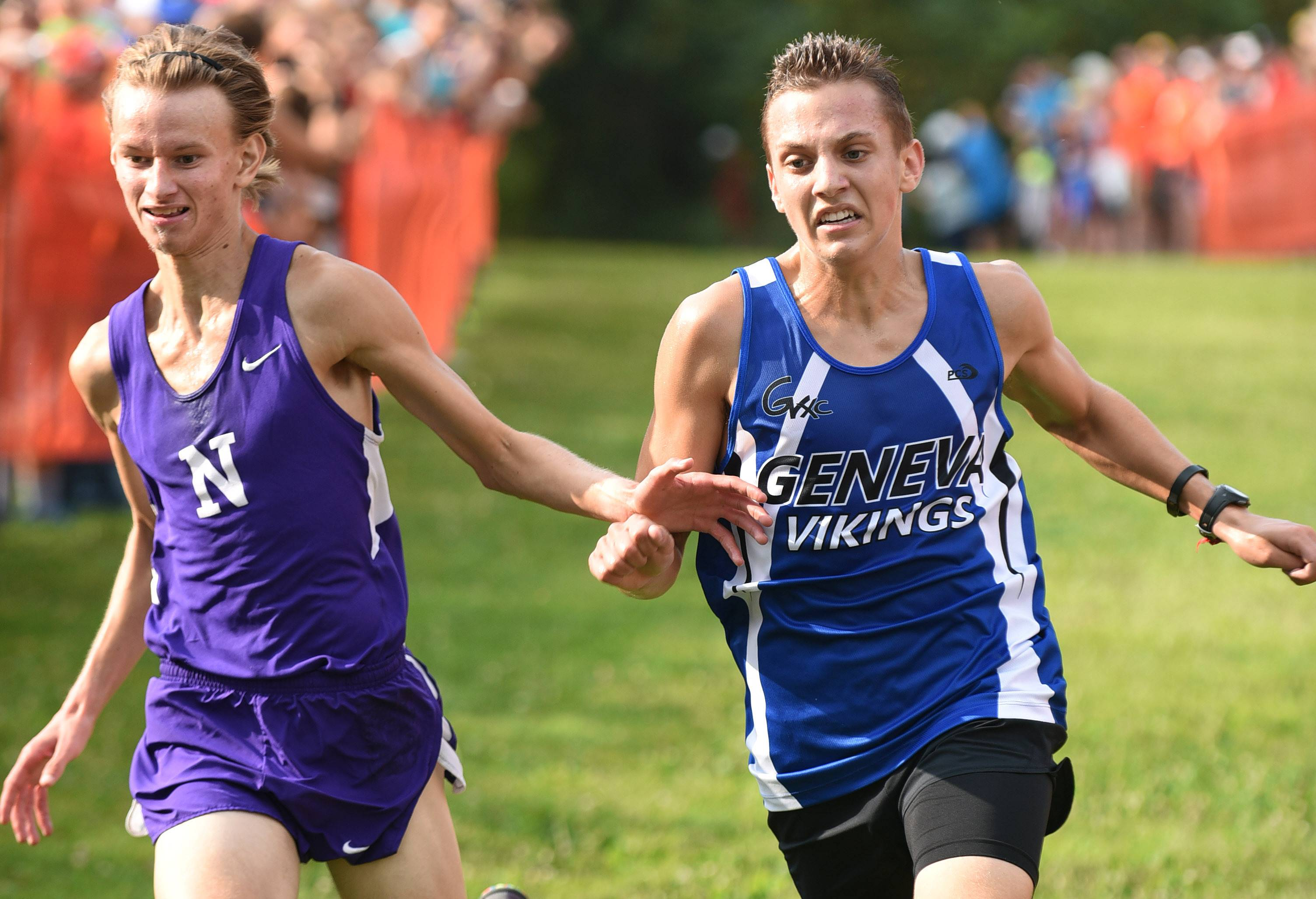 Laura Stoecker/lstoecker@dailyherald.comDowners Grove North's Robbie Prescott, left, is disqualified for trying to hold off Geneva's Tyler Dau at the finish line in the boys varsity run in the St. Charles East Leavey Invitational at LeRoy Oakes Forest Preserve in St. Charles Saturday.
