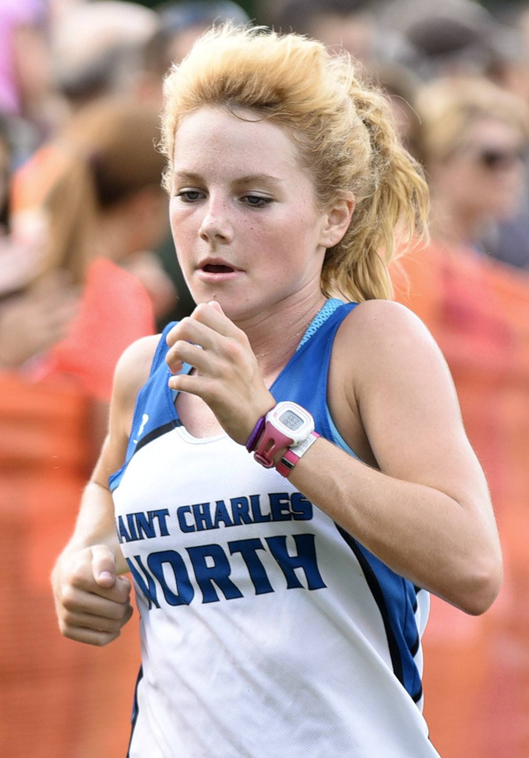 Laura Stoecker/lstoecker@dailyherald.comSt. Charles North's Audrey Ernst nears the finish line to take fourth place in the girls varsity run in the St. Charles East Leavey Invitational at LeRoy Oakes Forest Preserve in St. Charles Saturday.