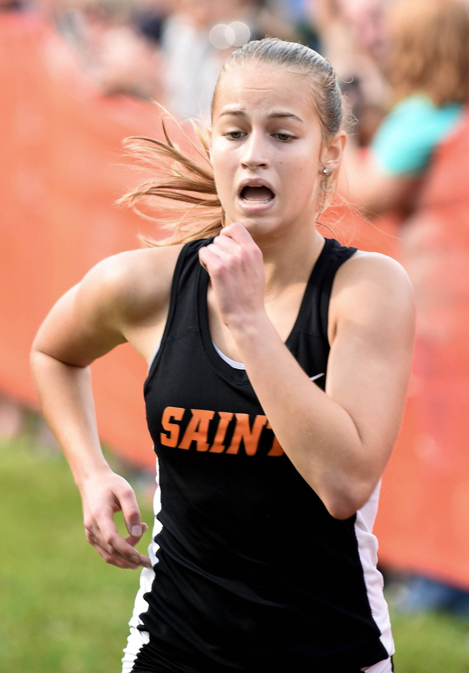 Laura Stoecker/lstoecker@dailyherald.comSt. Charles East's Hannah Ewald struggles to the finish line to take 14th place for the Saints in the St. Charles East Leavey Invitational at LeRoy Oakes Forest Preserve in St. Charles Saturday. She collapsed just past the finish line.