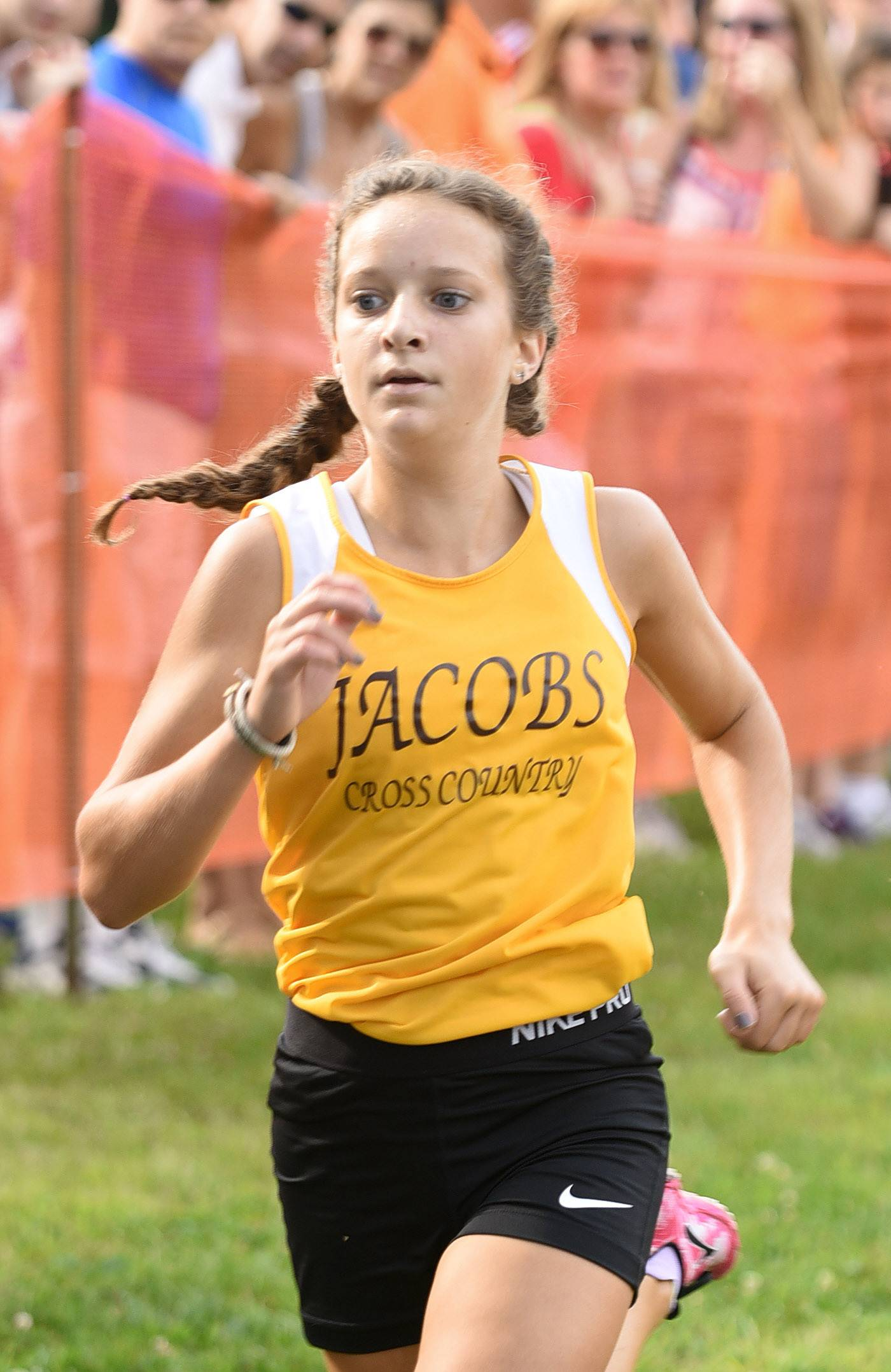 Laura Stoecker/lstoecker@dailyherald.comJacobs' Chloe Walsh finishes first for her team and 16th overall in the girls varsity run in the St. Charles East Leavey Invitational at LeRoy Oakes Forest Preserve in St. Charles Saturday.