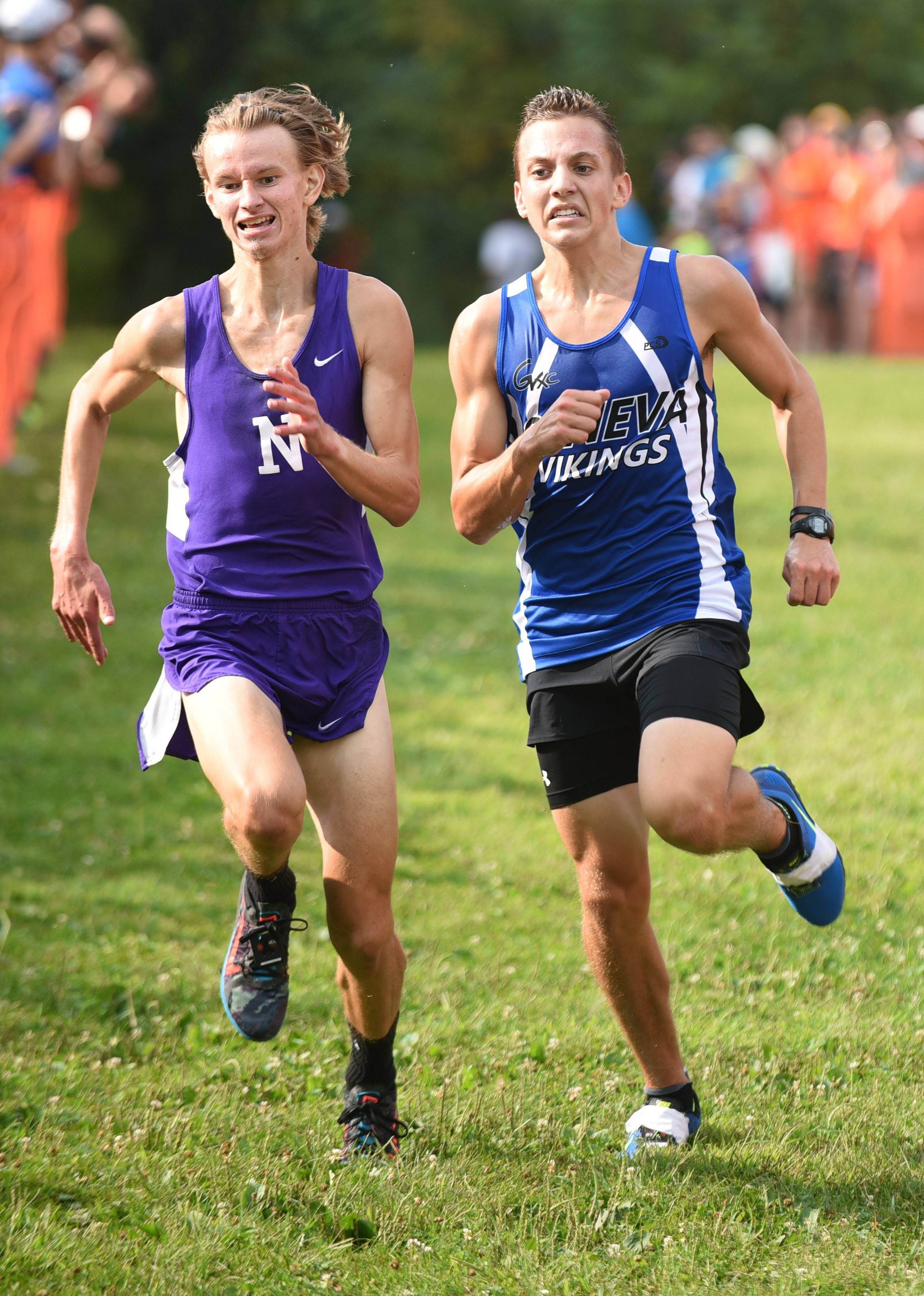 Laura Stoecker/lstoecker@dailyherald.comDowners Grove North's Robbie Prescott, left, and Geneva's Tyler Dau battle to the finish line at the finish line in the boys varsity run in the St. Charles East Leavey Invitational at LeRoy Oakes Forest Preserve in St. Charles Saturday. Prescott was later disqualified for using his arm to try and hold back Dau from finishing before him.