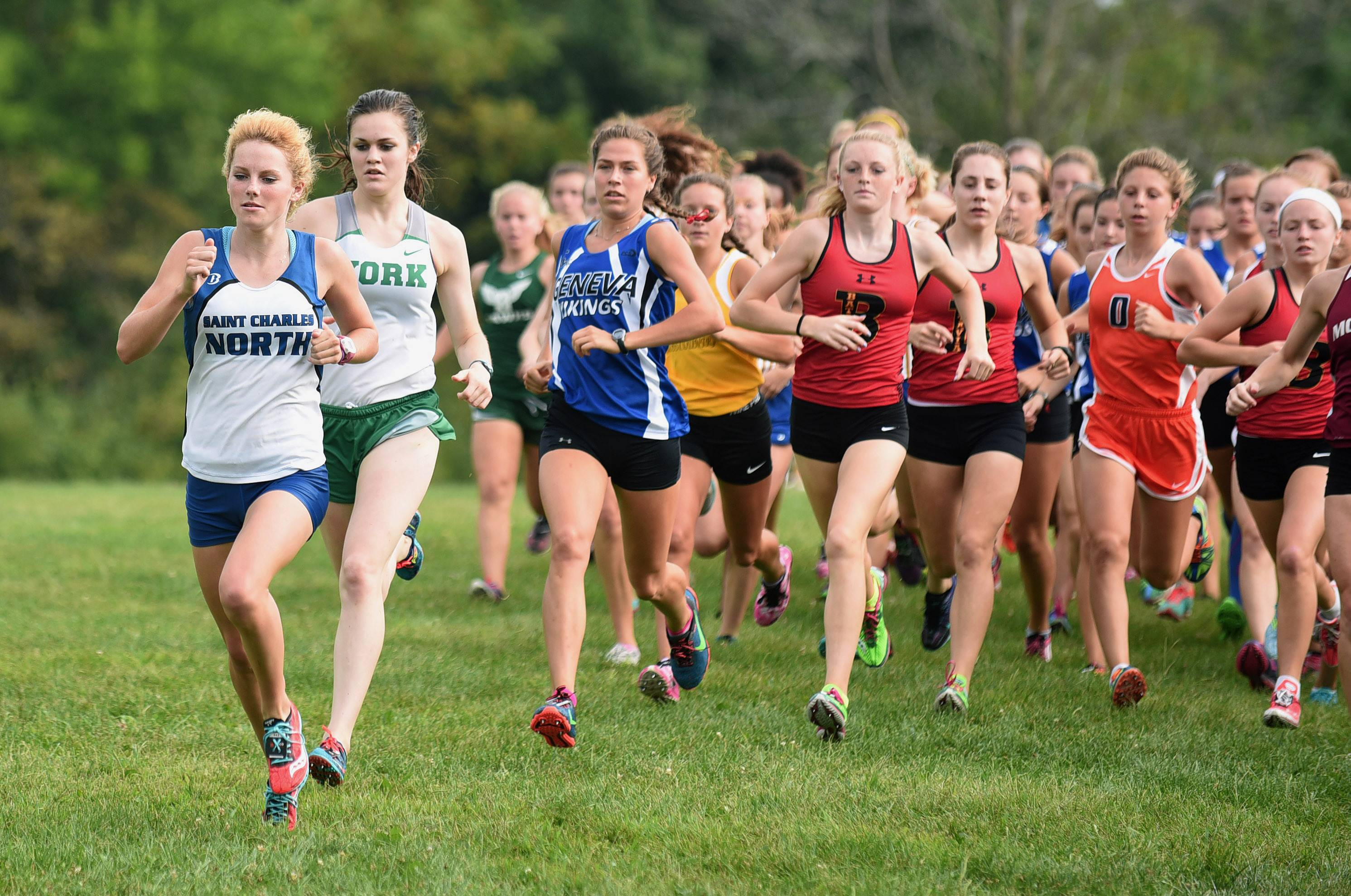 Laura Stoecker/lstoecker@dailyherald.comSt. Charles North's Audrey Ernst leads the pack at the start of the girls varsity run at the St. Charles East Leavey Invitational at LeRoy Oakes Forest Preserve in St. Charles Saturday.