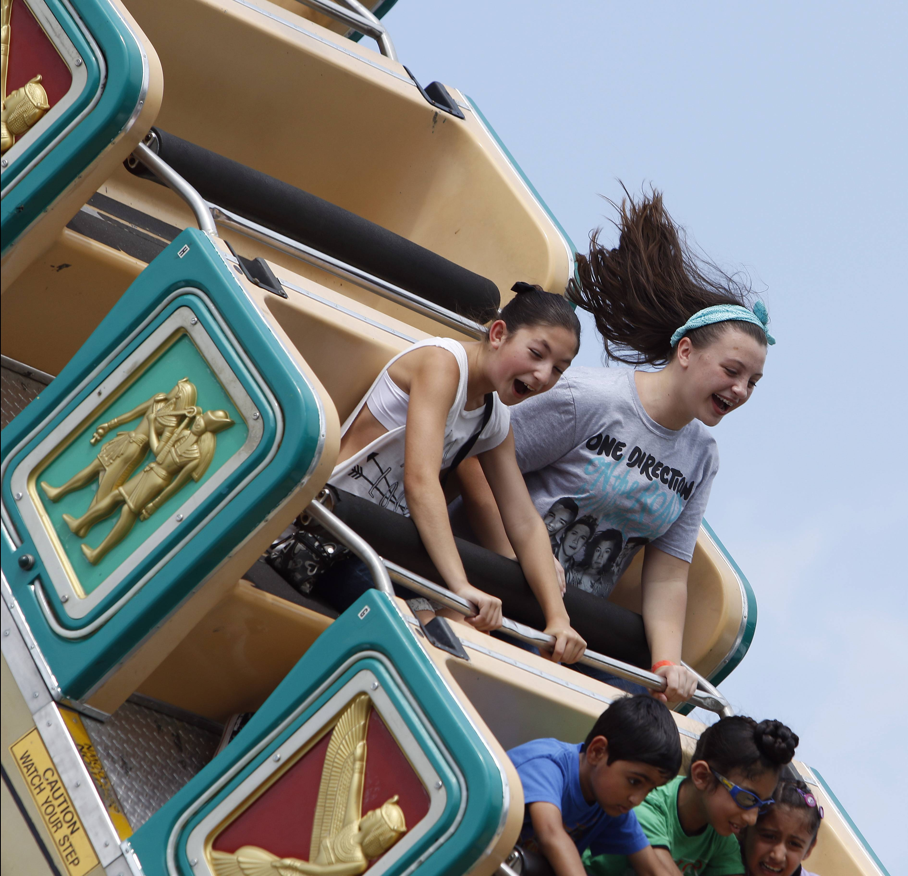 Raelyn Scollard, 12, right, and Cassidy Morisco, 11, both of Schaumburg scream their way through a ride on the Pharaoh's Furry Saturday during the three-day Septemberfest in Schaumburg.