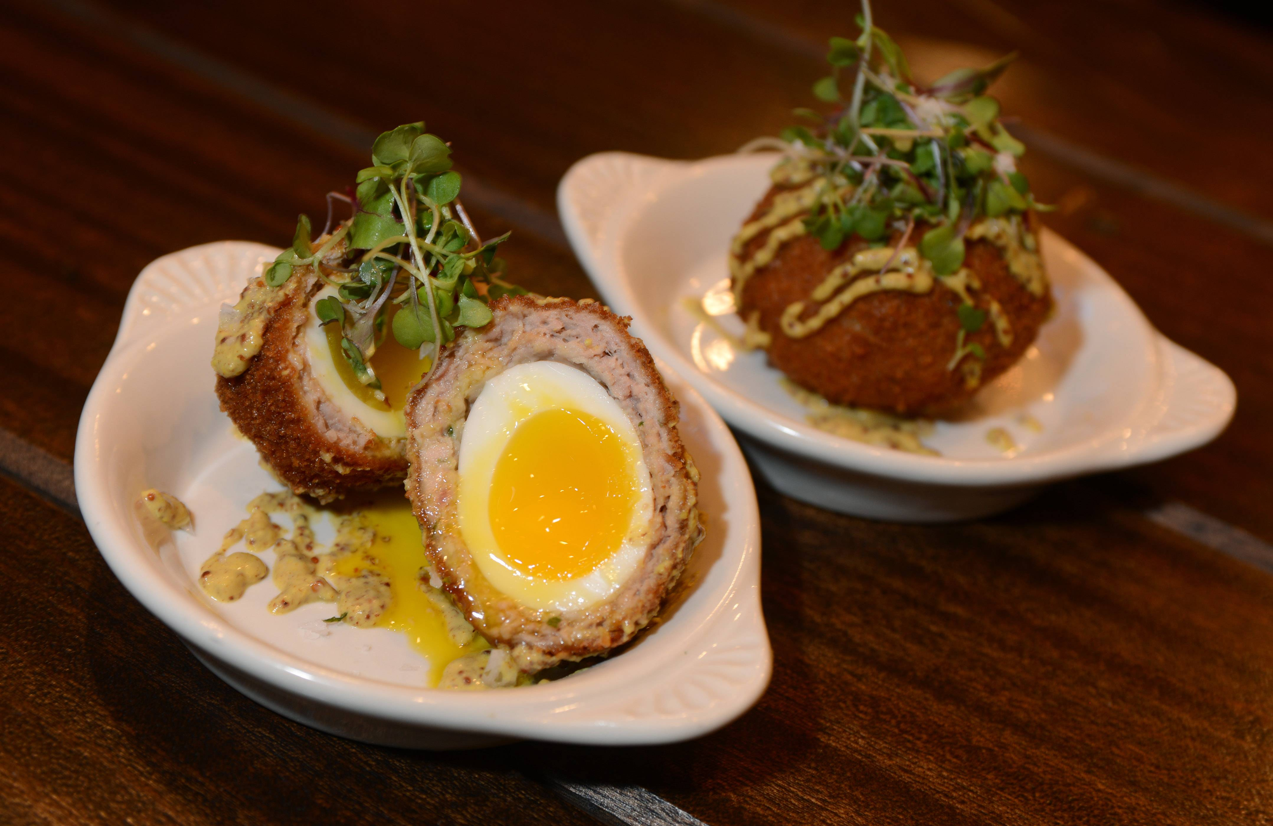 The Scotch egg (a soft-boiled egg wrapped in sausage and fried) was complemented by microgreens and a spicy beer mustard at O'Toole's of Libertyville.