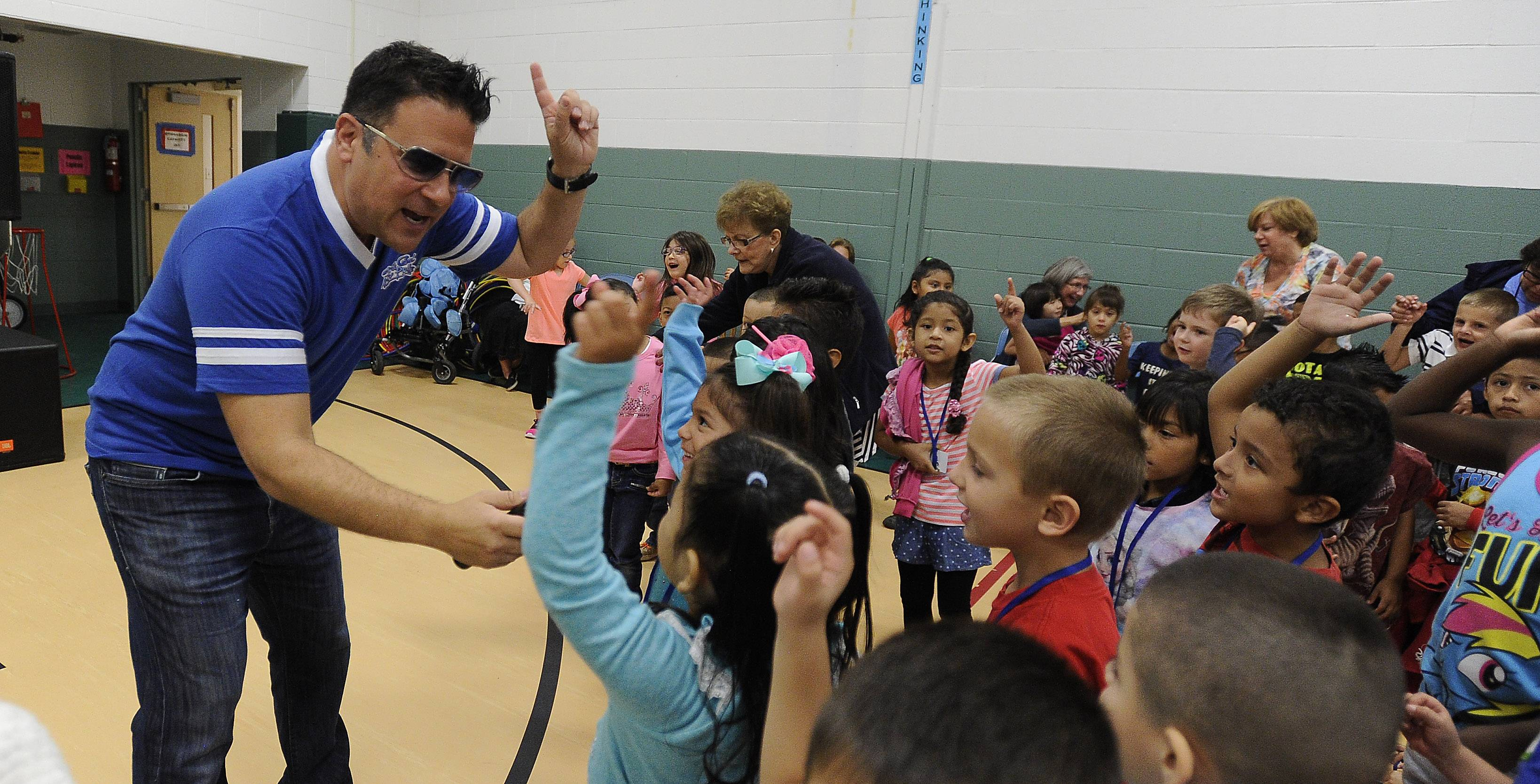"Jeff Bizar, of Deerfield, aka ""Dr. Cool,"" entertains the kids of Rupley School in Elk Grove Village with positive messages. His show has been turned into a new Sunday morning kids TV series, ""Dr. Cool and Pride: The Big Show,"" on WTTW."