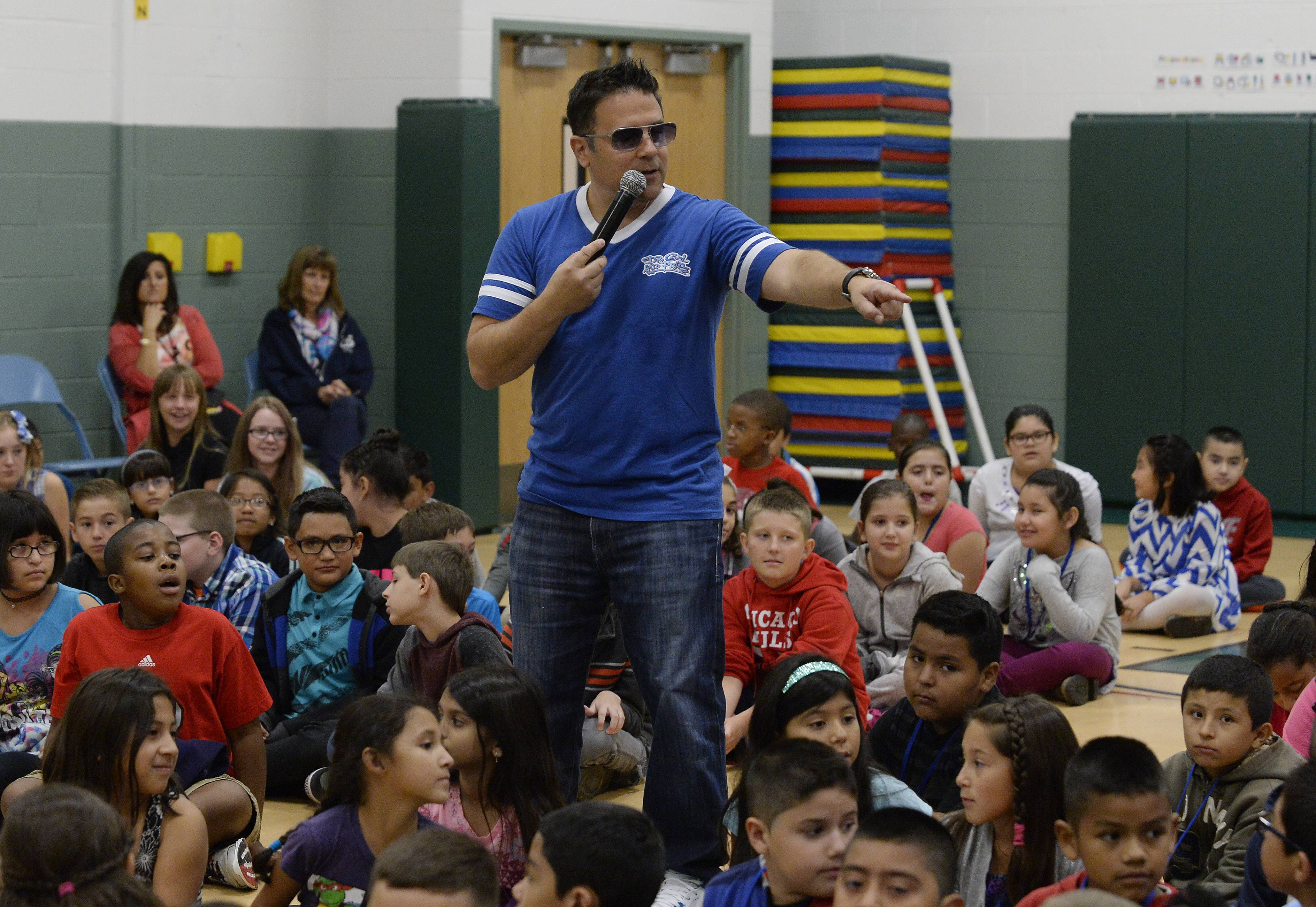 "Jeff Bizar, of Deerfield, aka ""Dr. Cool"" entertains the kids of Rupley School in Elk Grove Village with music and empowering messages. His show has been turned into a new Sunday morning kids TV series ""Dr. Cool and Pride: The Big Show"" on WTTW."