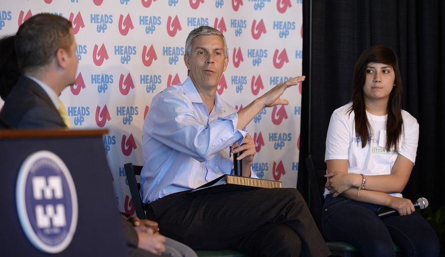U.S. Secretary of Education Arne Duncan talks with other panel members including Ivette Castanon, 14, of Palatine High School, right, at Harper College. Duncan was at Harper Wednesday when the school was presented with a $1 million donation to its Promise Scholar Program.
