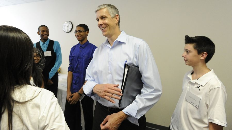 U.S. Secretary of Education Arne Duncan talks with high schoolers including Russel Wagner, 14, of Palatine High School, right, at Harper College. Duncan was at Harper Wednesday when the school was presented with a $1 million donation to its Promise Scholar Program.