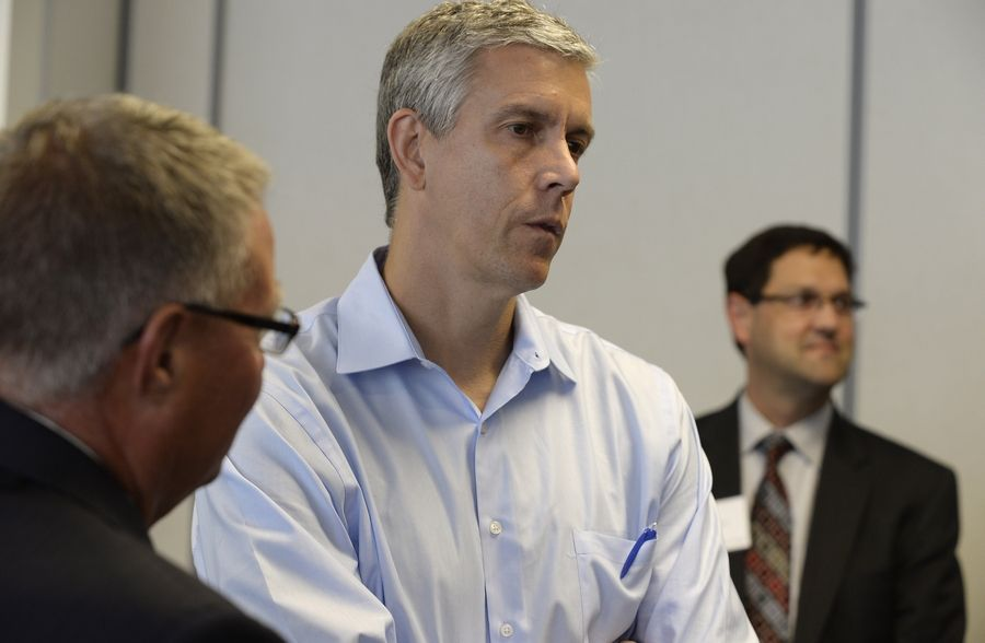 U.S. Secretary of Education Arne Duncan talks with members of Harper College on Wednesday. He was there to support its Promise Scholar Program.