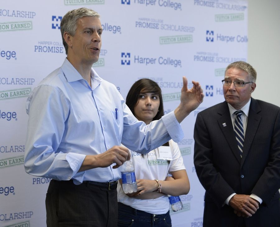 U.S. Secretary of Education Arne Duncan talks with members of Harper College on Wednesday as Ivette Castanon, 14, of Palatine High School and Ken Ender, president of Harper, look on. Duncan was at Harper to support its Promise Scholar Program.
