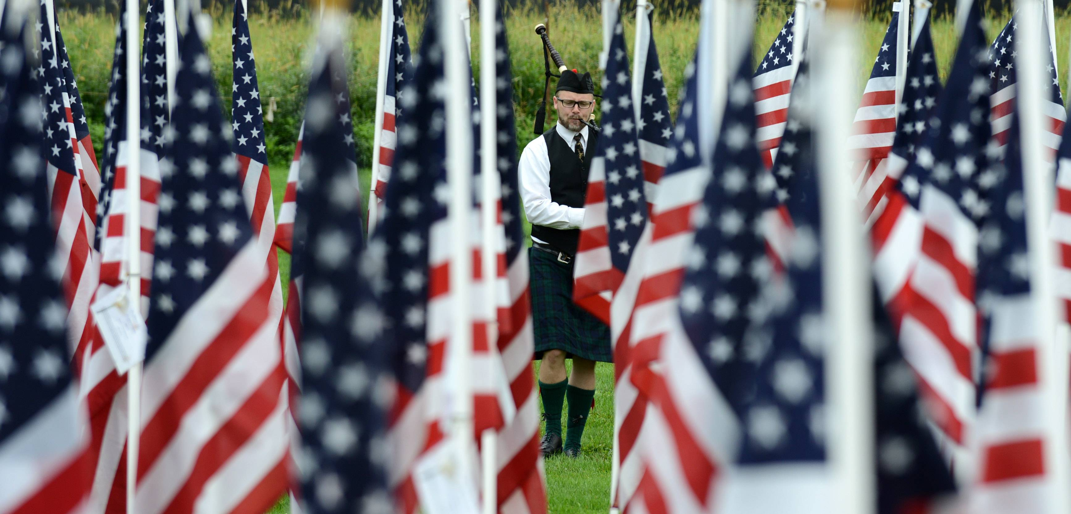 Bagpiper Adam Parchert of Carpentersville plays during a Sept. 11 remembrance ceremony at the Carpentersville Fire Department Friday.
