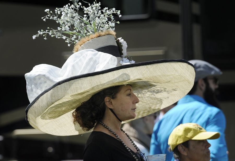 Gretchen Von Hess, an artist from Barrington Hills, shows off her hat Saturday at the 11th annual LeCompte/Kalaway Trailowners Cup in Barrington Hills.