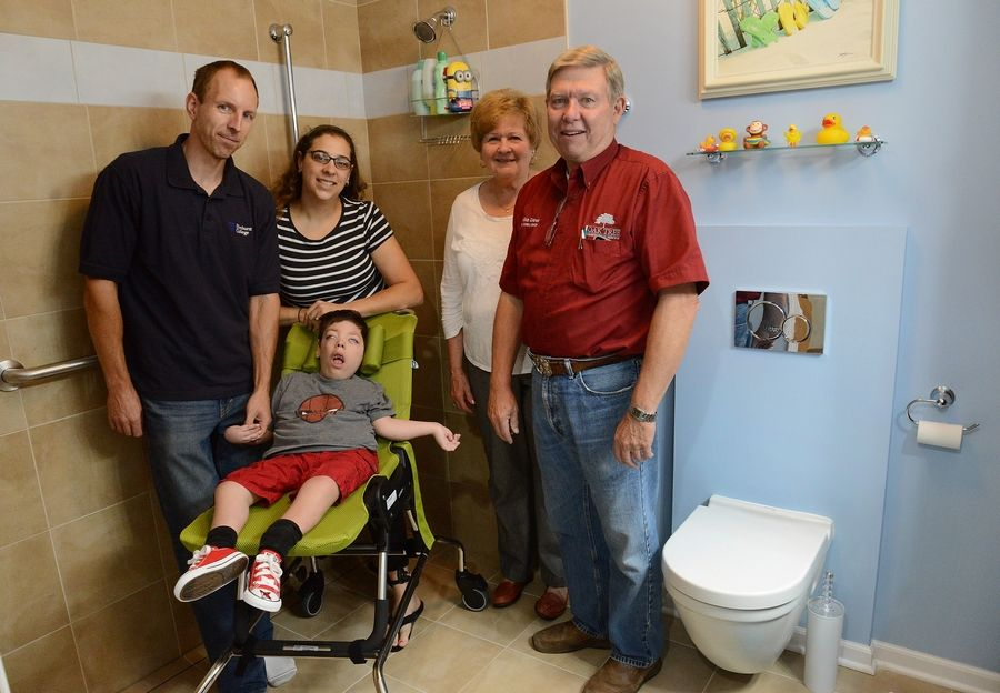 From left, Jeff and Stacy Fulkerson with son James, and Donna and Mike Dew of Oak Tree Construction in the Fulkersons' newly remodeled bathroom.
