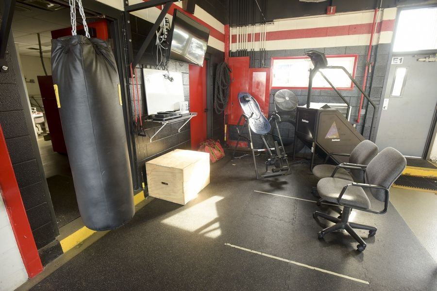 Workout equipment is squeezed into the apparatus floor at the station, long overdue for renovations, Carol Stream Fire Protection District leaders say.