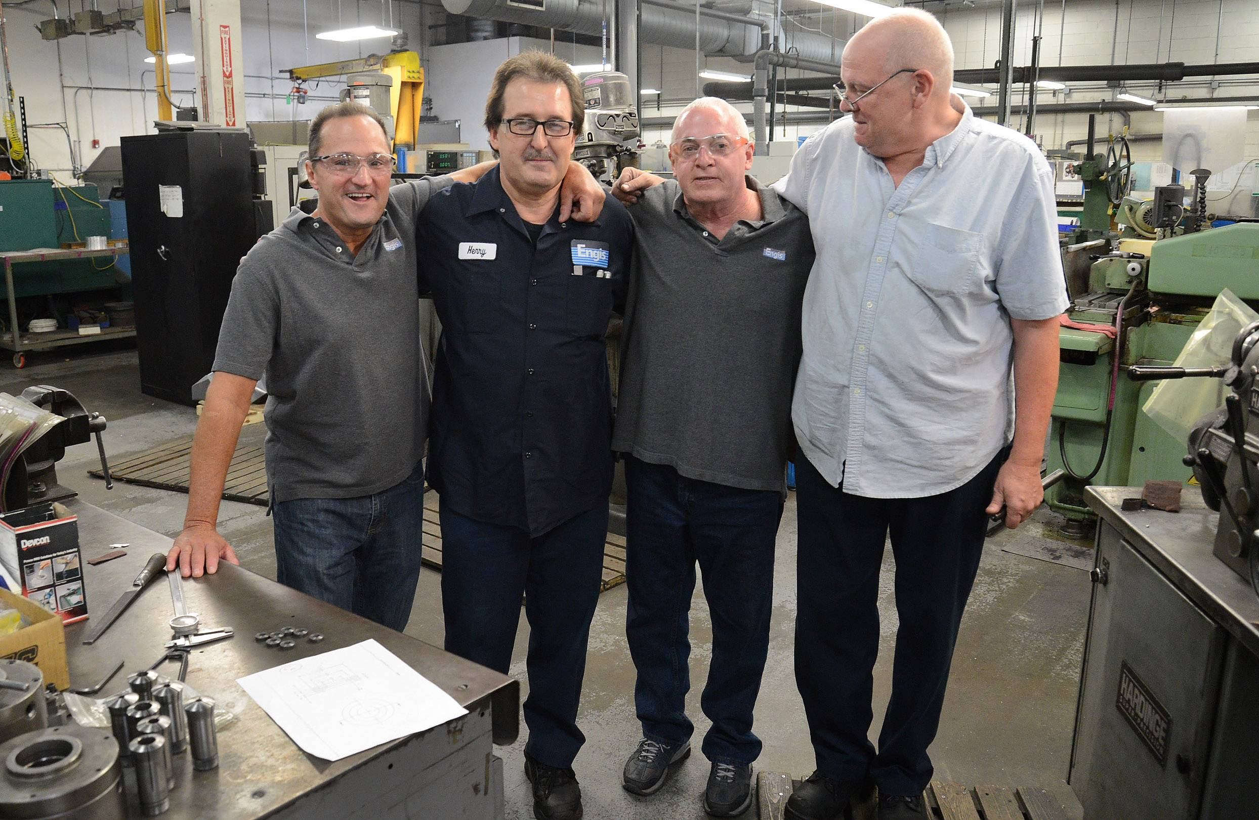 Engis Corp. co-workers from left Greg Nania, Henry Kosinski, Doug Jones and Ron Ghiselli reunite at Kosinski's workstation where they found him after he experienced cardiac arrest and assisted on saving his life.