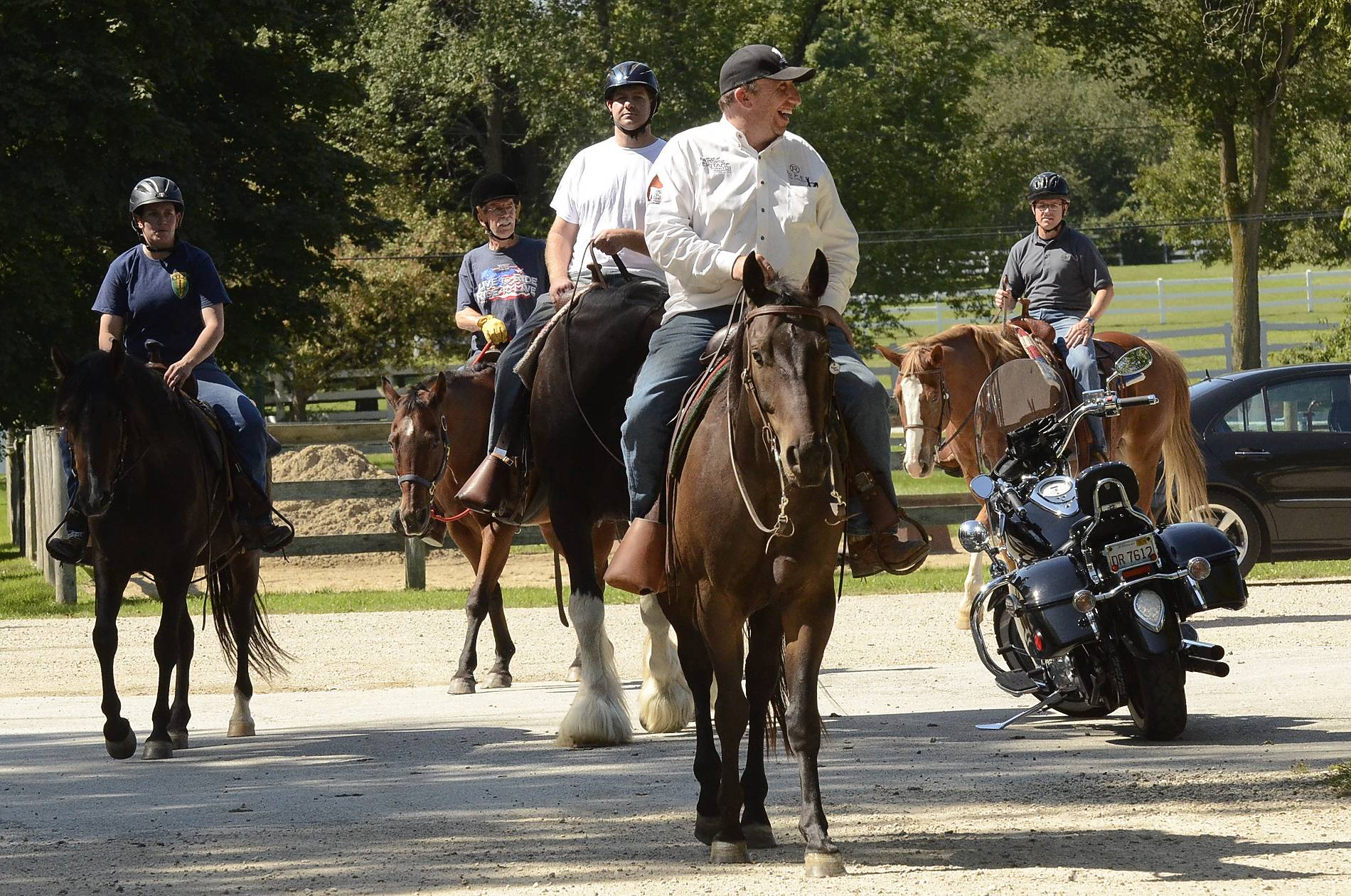 "Patrick ""Paddy"" McKevitt leads a group of riders out on a trail Monday at the Barrington Hills Riding Center in Barrington Hills. McKevitt is director of operations for BraveHearts, which runs the country's largest equine therapy program for military veterans."