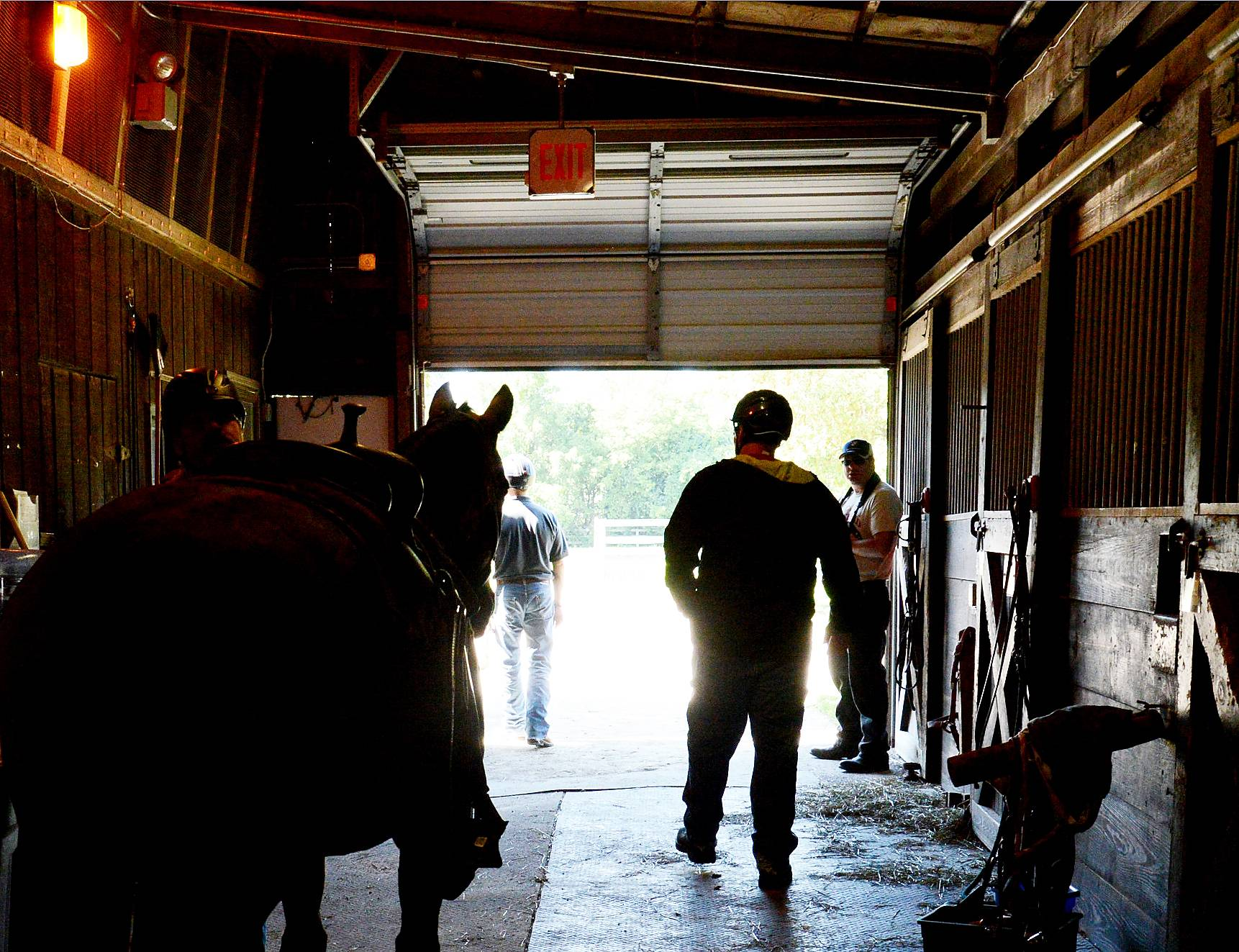 Riders prepare to set out on a trail ride Monday, as about 45 military veterans took part in a equine therapy event at the Barrington Hills Riding Center in Barrington Hills.