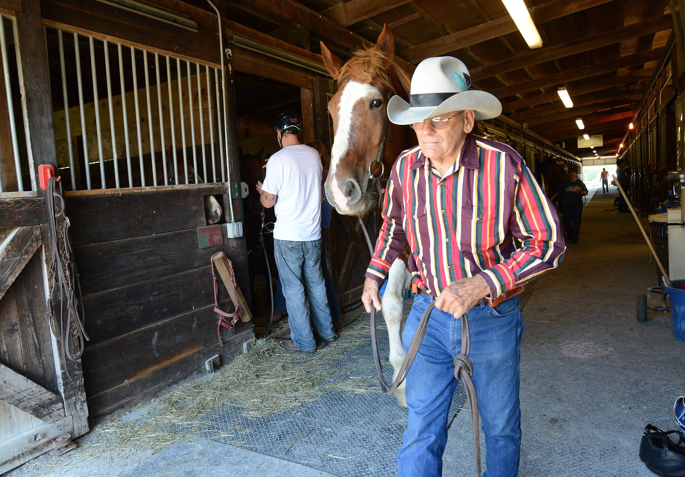 Riders prepare to ride out on the trail Monday, as about 45 military vets take part in an equine therapy event at the Barrington Hills Riding Center in Barrington Hills.