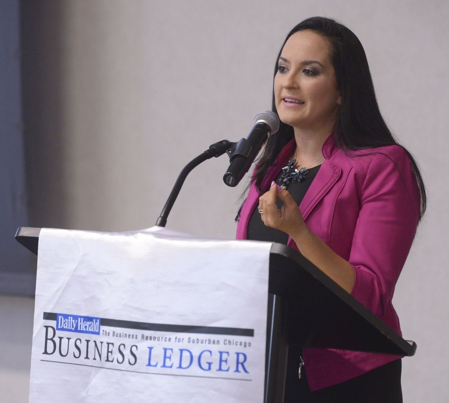 Mark Black/mblack@dailyherald.comKeynote speaker Jacqueline Camacho-Ruiz speaks at the 16th annual Daily Herald Business Ledger Entrepreneurial Excellence Awards, held on the NIU Naperville campus Wednesday.