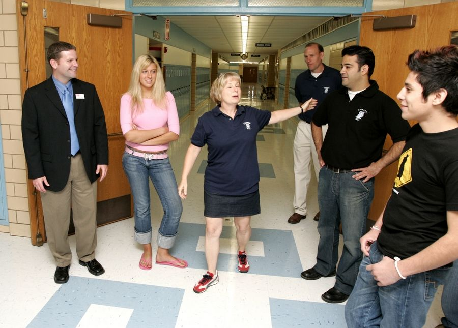 ELL coordinator Shelia Heck, center, gives a tour during first day of classes at Prospect High School in Mt. Prospect in 2005. District 214 and its feeder districts are starting to debate changing the start of the school calendar and class starting times.
