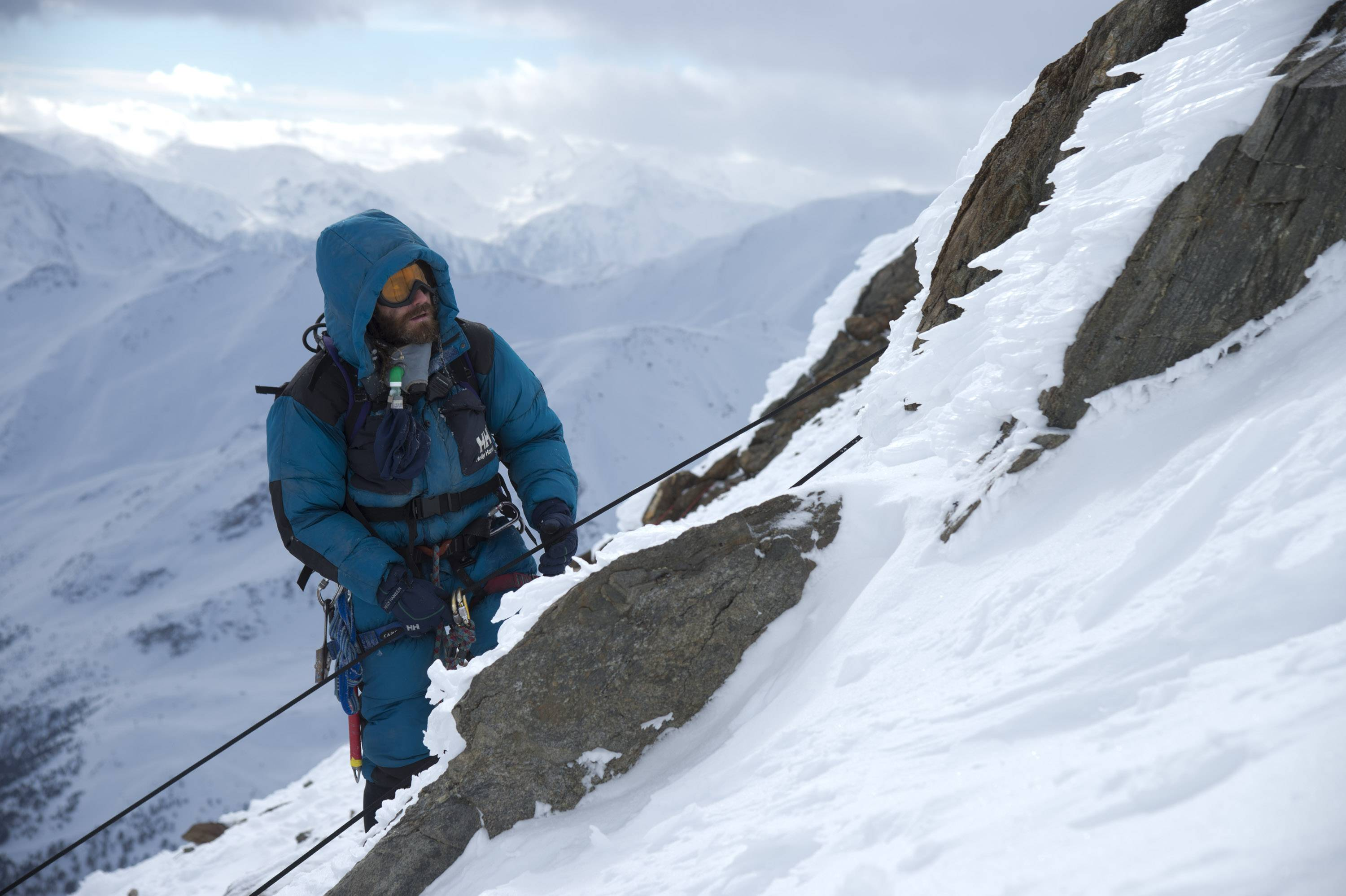 "Team leader Scott Fischer (Jake Gyllenhaal) contemplates how to survive a surprise storm while ascending ""Everest."""