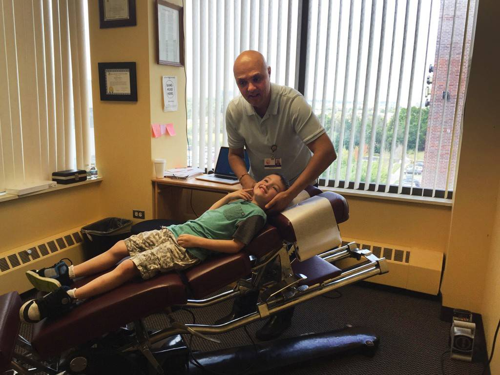 Chiropractor Dr. Chirag H. Shah has a family-friendly office in Hoffman Estates where he treats adults and children, including Kayne McCauley, age 5, of South Elgin. Shah says chiropractic care can optimize health and allow the body to work more effectively.