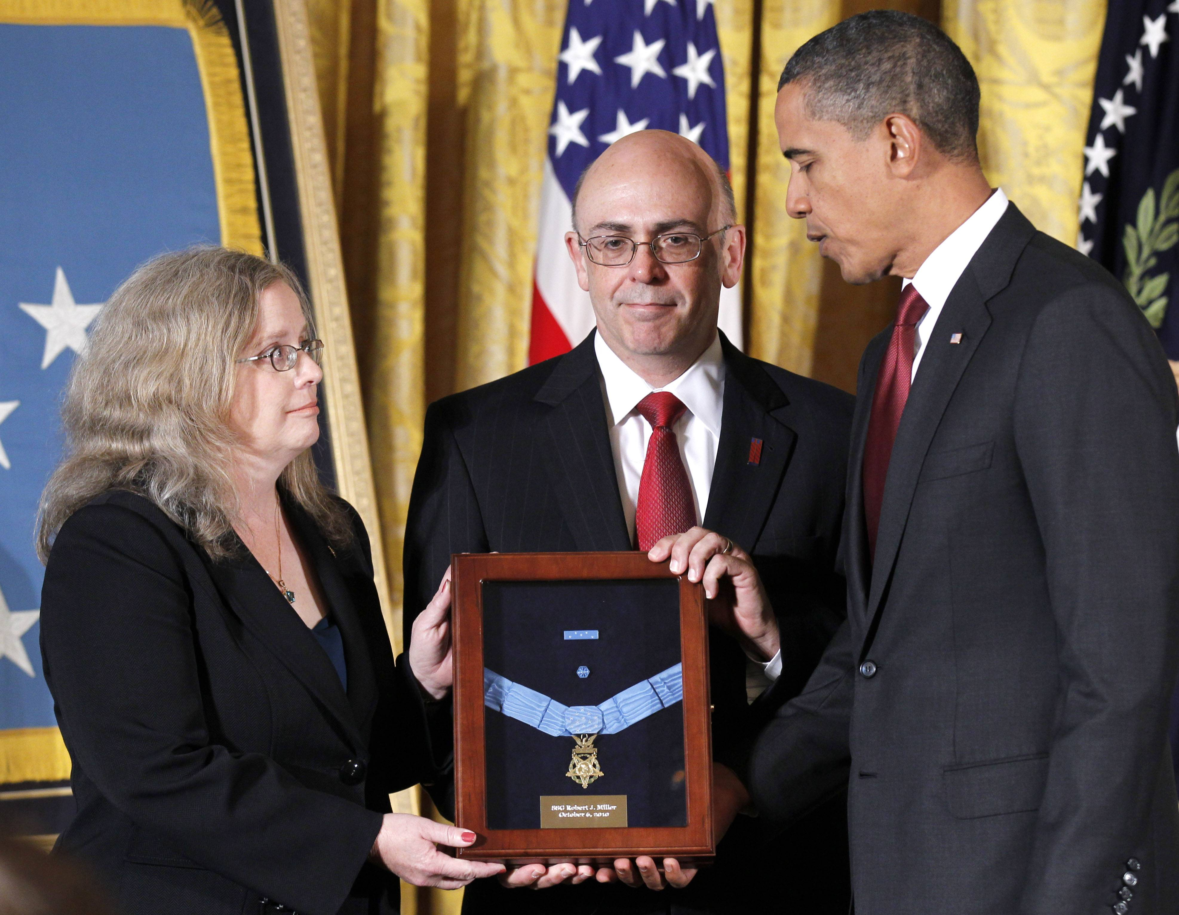 President Barack Obama presented the Medal of Honor posthumously to the parents of U.S. Army Staff Sgt. Robert J. Miller -- Phil and Maureen Miller -- in 2010.