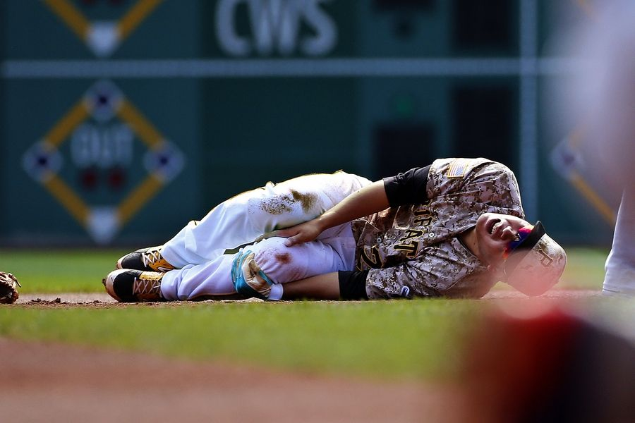 Pirates shortstop and rookie of the year candidate Jung Ho Kang suffered a torn left MCL and a fractured tibia when the Cubs' Chris Coghlan slid hard into him trying to break up a double play in the first inning of Thursday's game in Pittsburgh. Kang will reportedly be out 6-8 months. On Friday, Cubs manager Joe Maddon said he felt horrible for Kang, but the play was a 'good baseball play.""