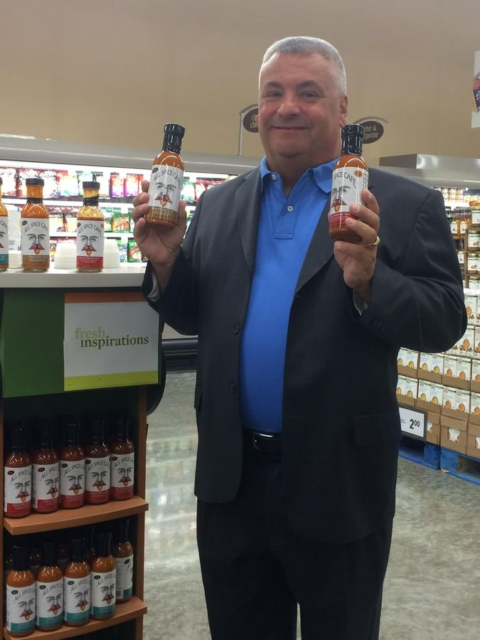 Michael Brindza is one of the investors behind a new line of hot sauces called All Spice Cafe.