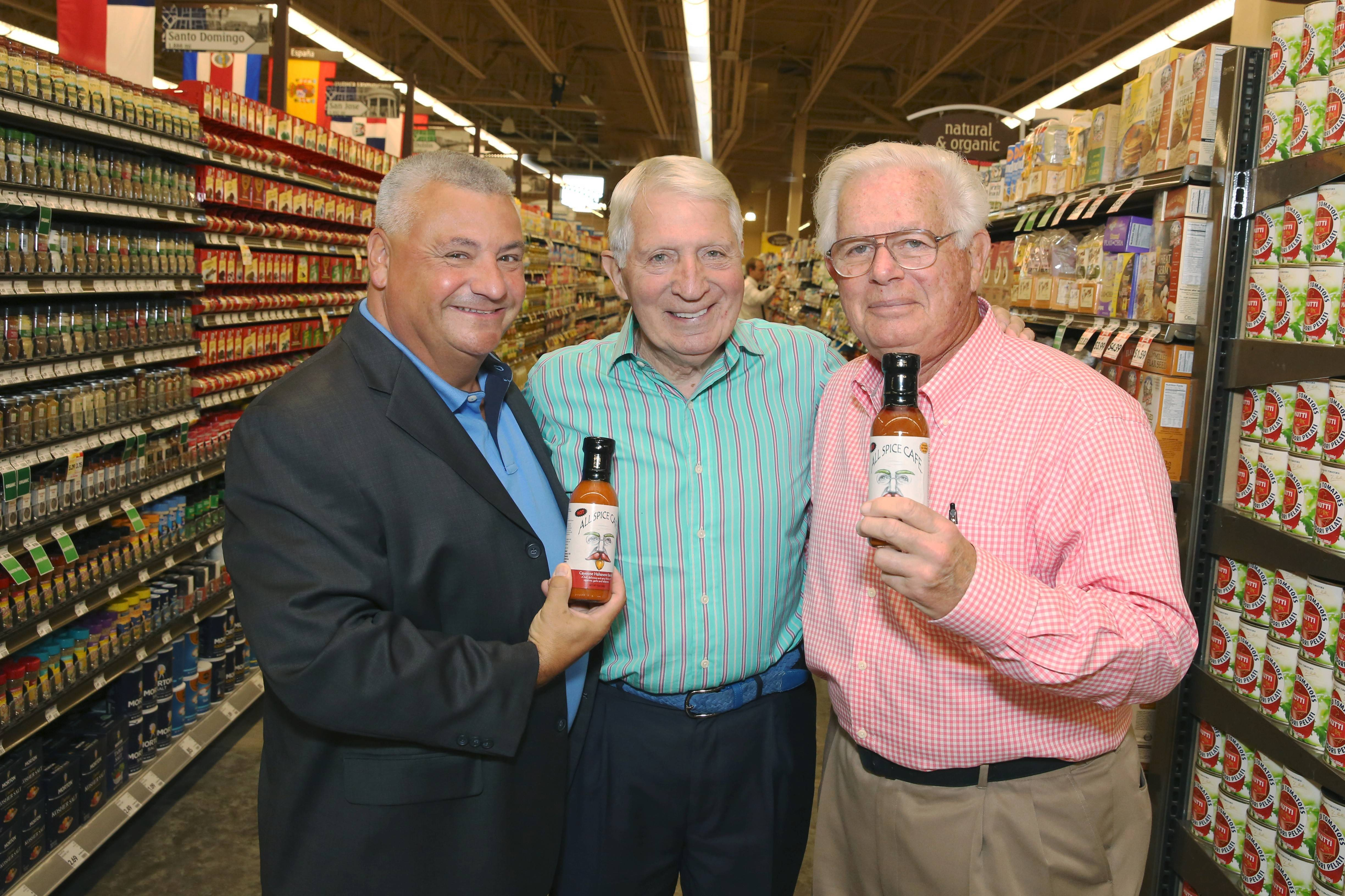 Michael Brindza, at left, Don Mazzoni and Buddy Feldman are backing a line of hot sauces called All Spice Cafe.
