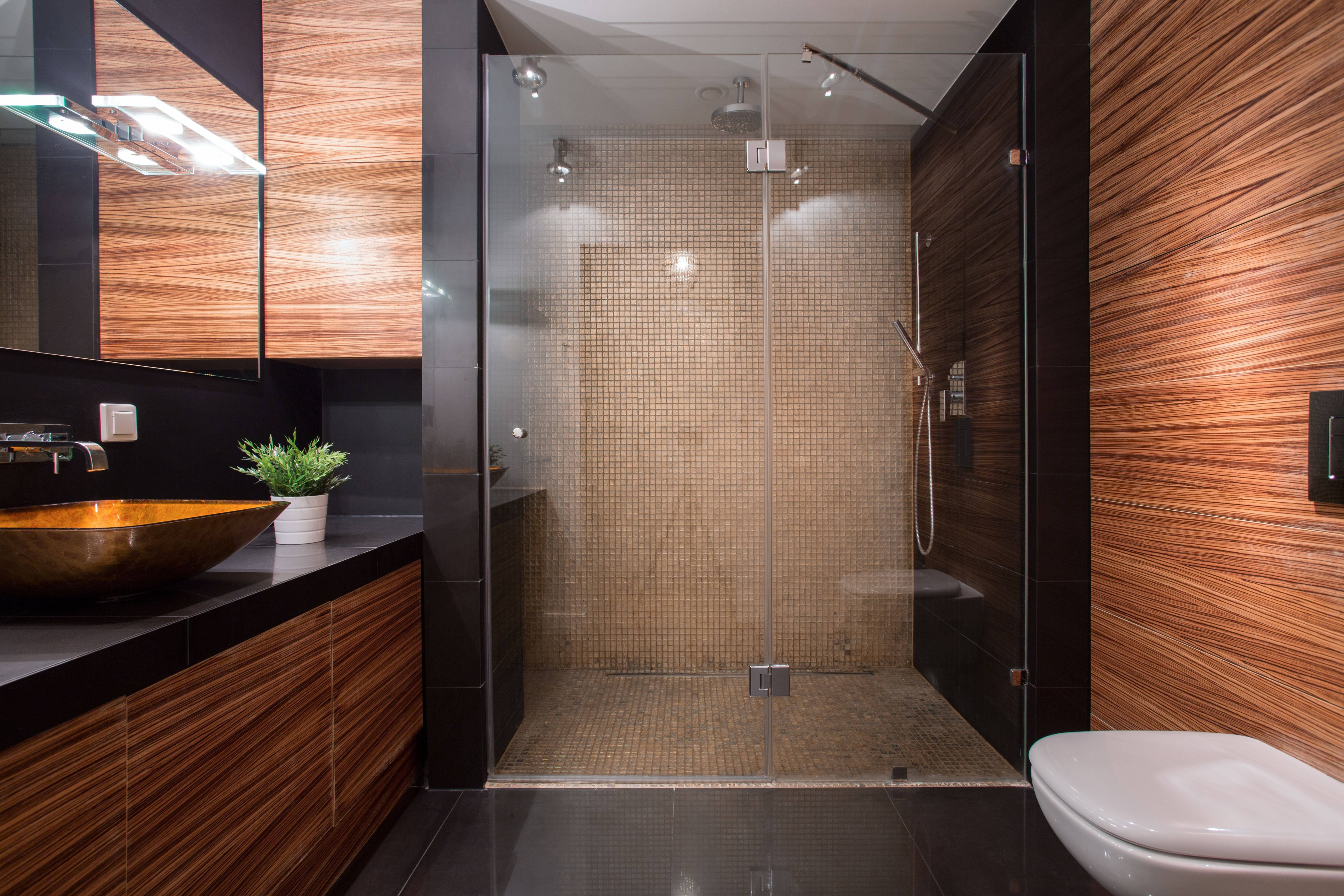 Clean mix-and-match: A blend of textures and materials, such as glass, wood, metal and stone, provides sleek, pleasing visual sightlines, and also creates a lighter, open feel in modern bathroom design.