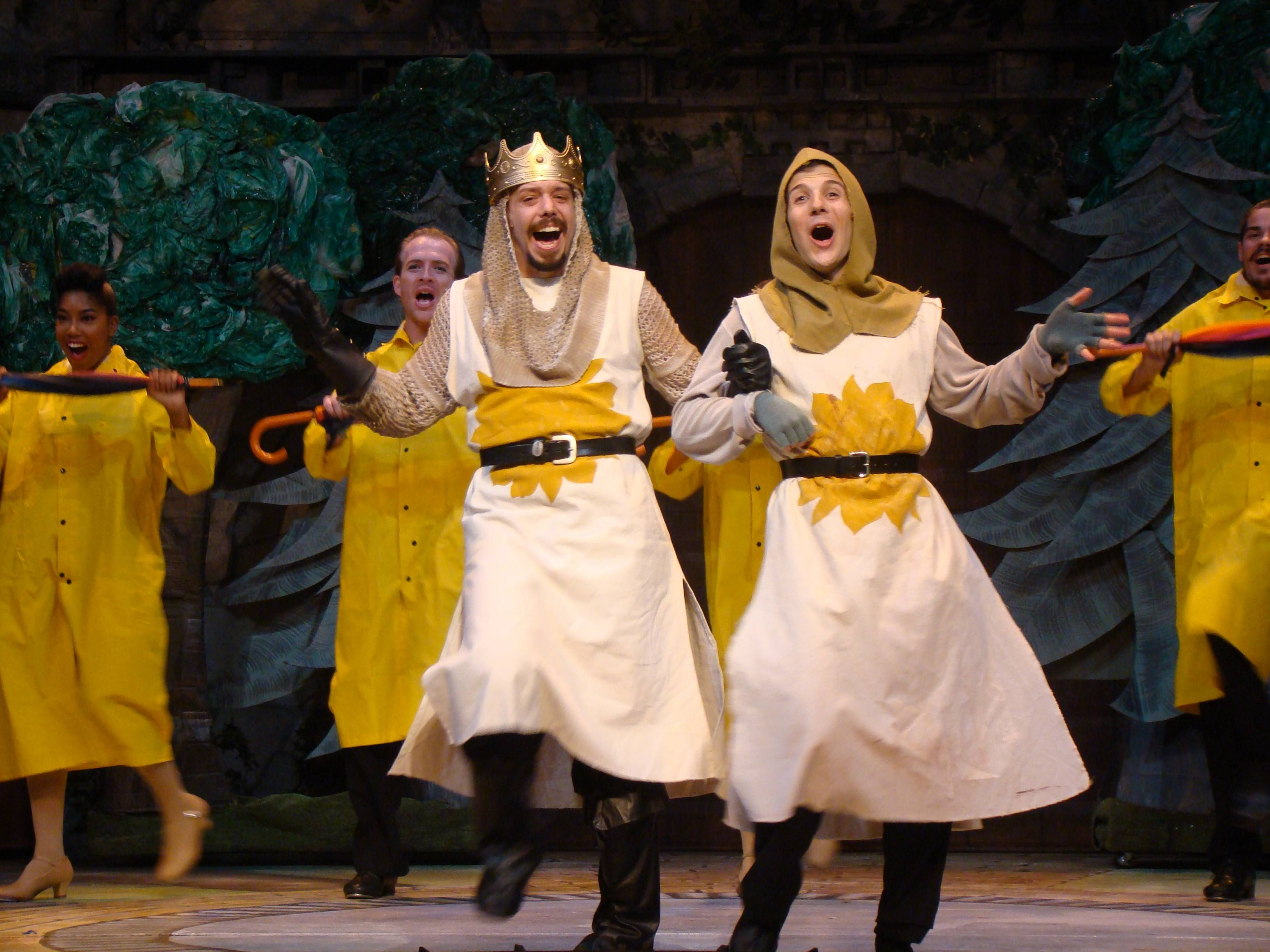 "King Arthur (Joe Bianco), left, and Patsy (Ryan J. Duncan) belt out a comic tune in Metropolis Performing Arts Centre's production of ""Spamalot."" The Monty Python musical runs through Oct. 25."