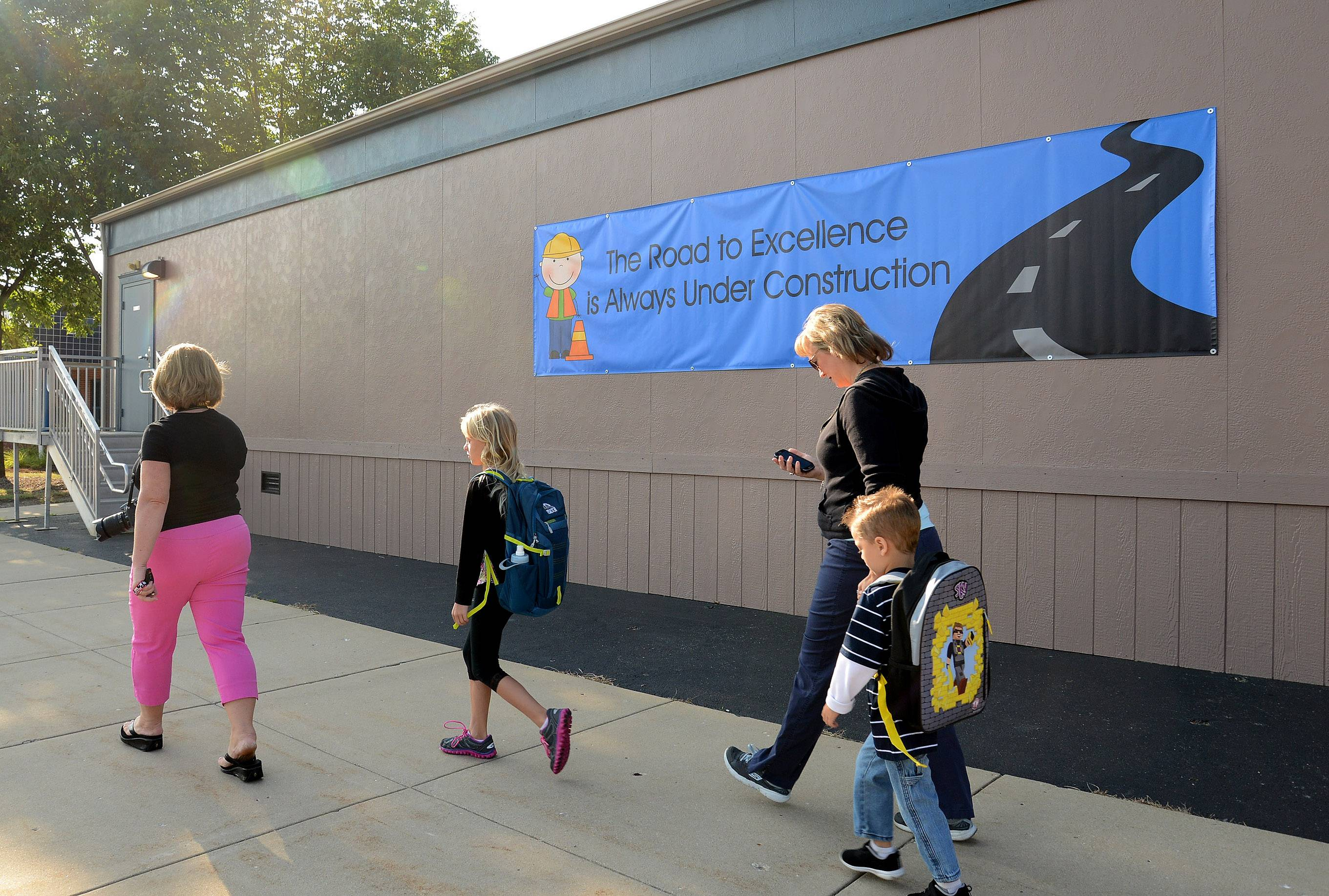 Students and parents walk past a new mobile classroom outside Ivy Hill Elementary School in Arlington Heights on the first day of school in August.