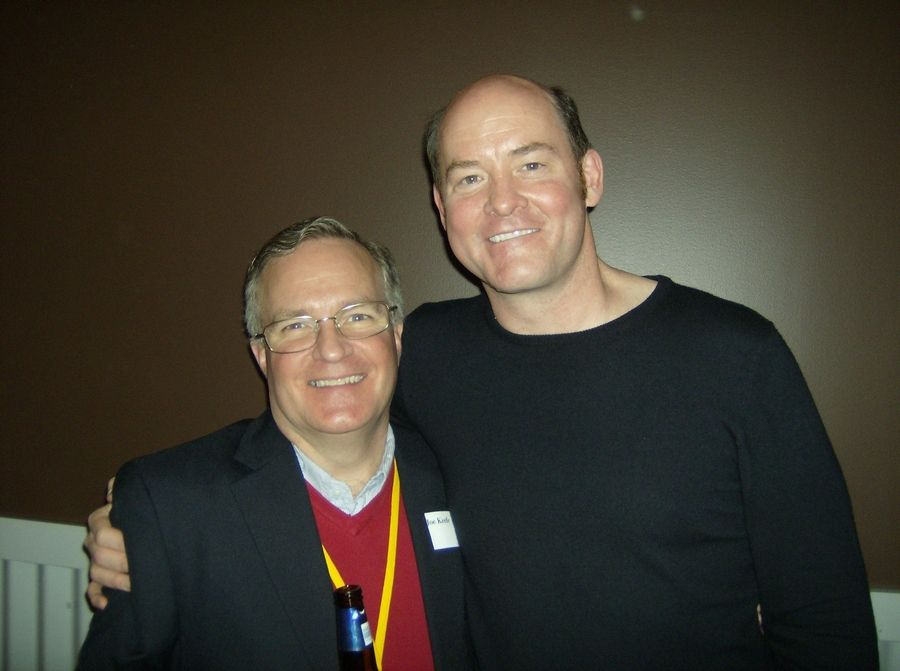 Metropolis Performing Arts Centre Executive Director Joe Keefe, of Glencoe, poses with actor and comedian David Koechner.