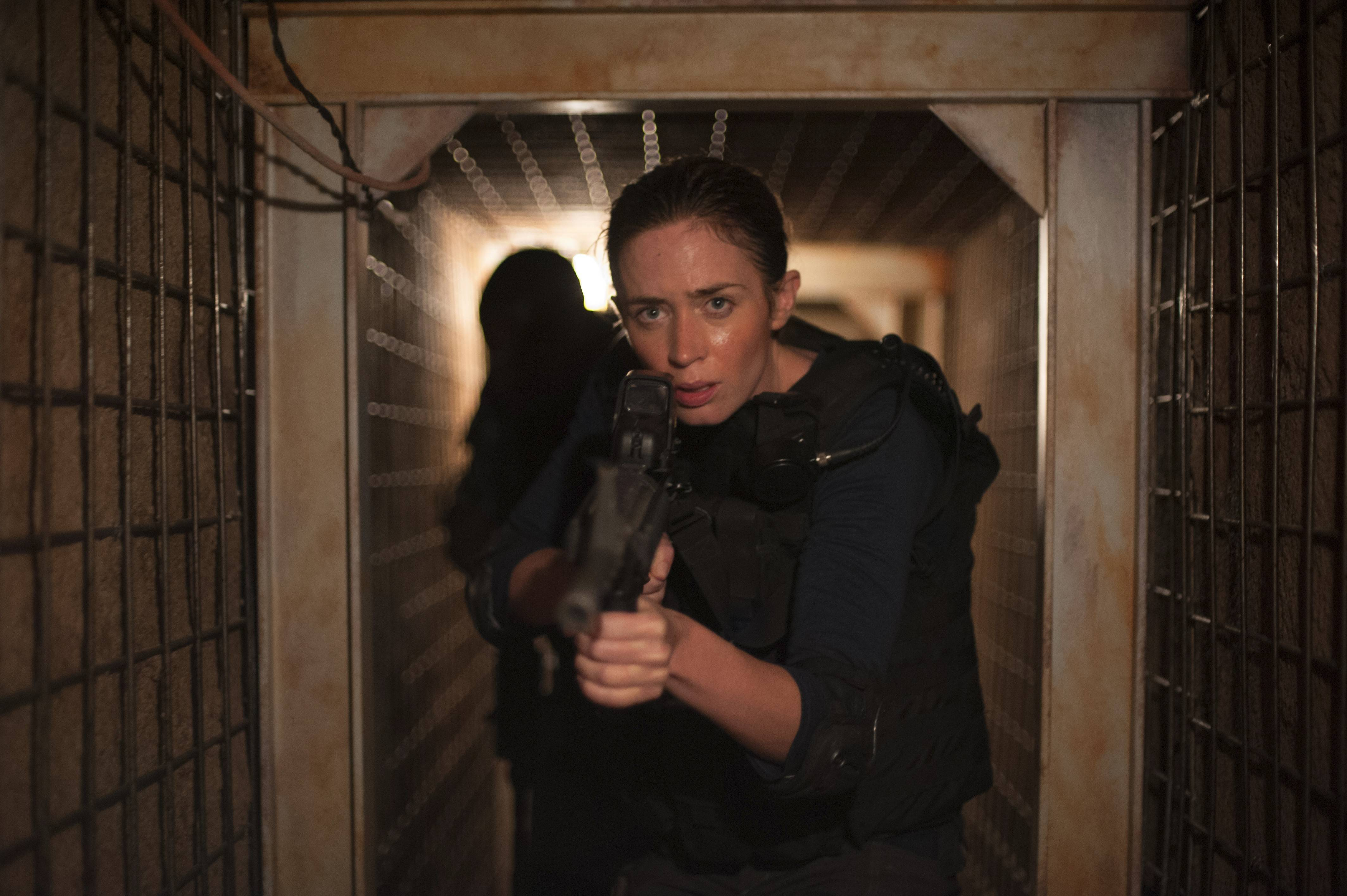 "FBI agent Kate Macer (Emily Blunt) checks out a secret tunnel created by a Mexican drug cartel in the political horror thriller ""Sicario."""