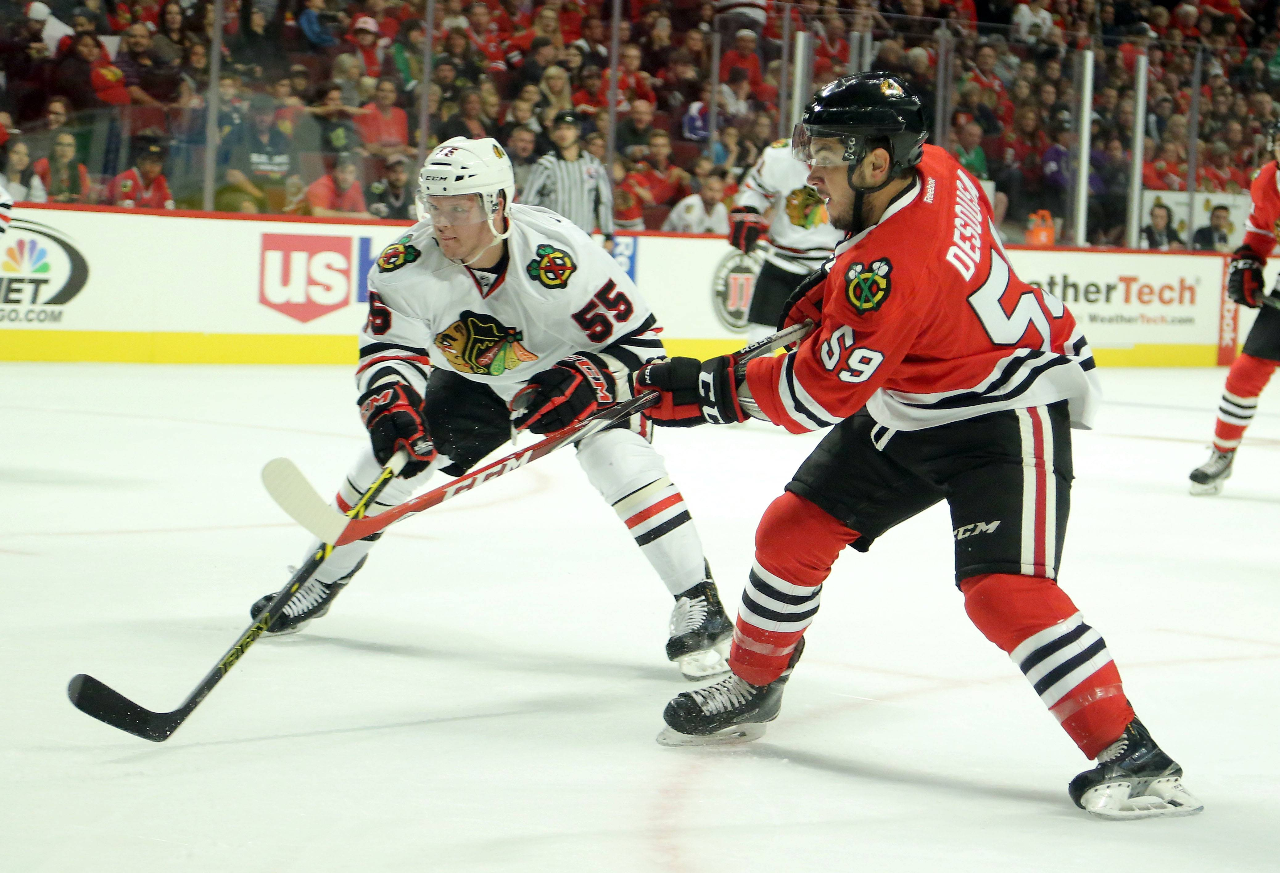 Chris DeSousa, right, shoots against Kirill Gotovets during the Blackhawks' Training Camp Festival scrimmage.