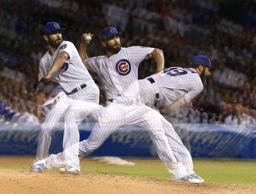 In this multiple exposure photo, Cubs starting pitcher Jake Arrieta delivers during the ninth inning of Tuesday's game against Milwaukee. Arrieta picked up his 20th win.