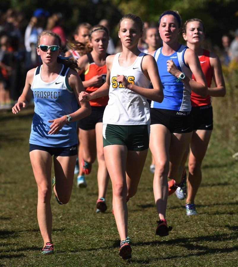 Event winner Isabelle Sparreo, middle, of Stevenson and second-place finisher Brooke Wilson, left, of Prospect are in front during the Palatine Invitational at Deer Grove East Forest Preserve on Saturday.