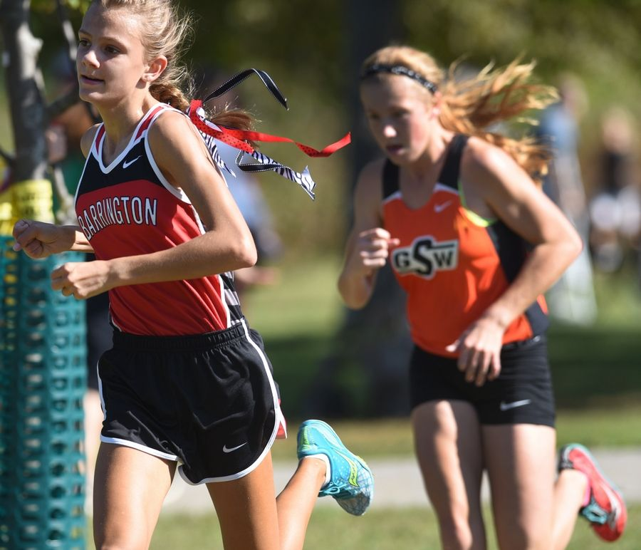 Jocelyn Long, left, of Barrington and Daly Galloway of Gardner South head toward the finish line for third- and fourth-place finishes, respectively, during the Palatine Invitational at Deer Grove East Forest Preserve on Saturday.