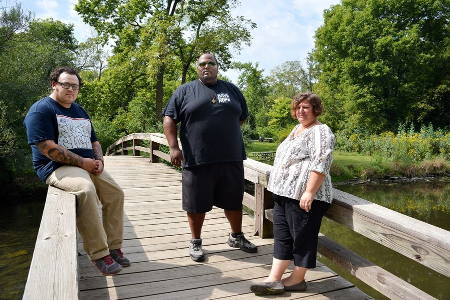 "The creators of ""I'm Fine,"" a short film about teen suicide, include Jonny Boucher, left, founder of a nonprofit suicide prevention group called Hope For The Day, Carl Evans, director of programs and operations for Hope For The Day, and AnnMarie Parker of Nickel A Day Films. Pioneer Park is one of their filming locations in Naperville."