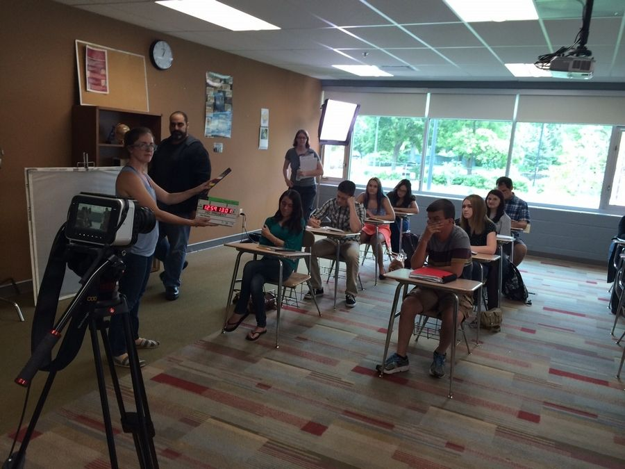 "Cast and crew members film a classroom scene for ""I'm Fine,"" much of which was shot in Naperville."