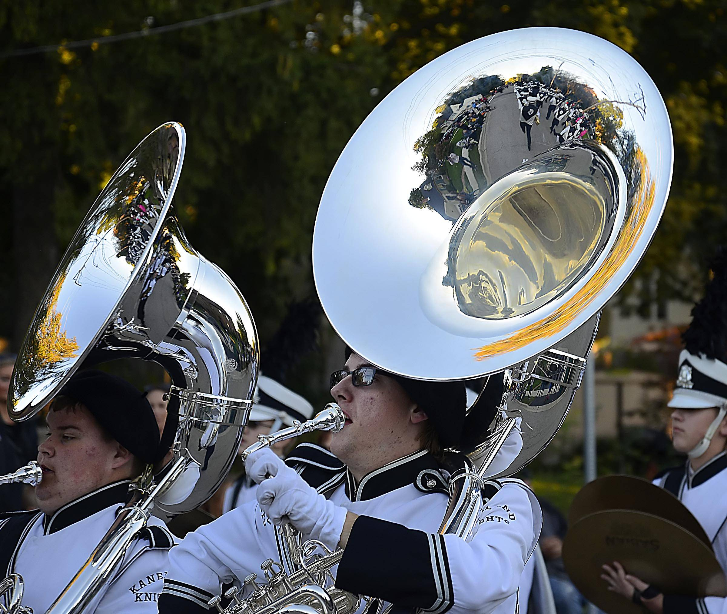 Tubas reflect the marching band as it moves up N. First St. in Elburn Wednesday during Kaneland High School's first homecoming parade.