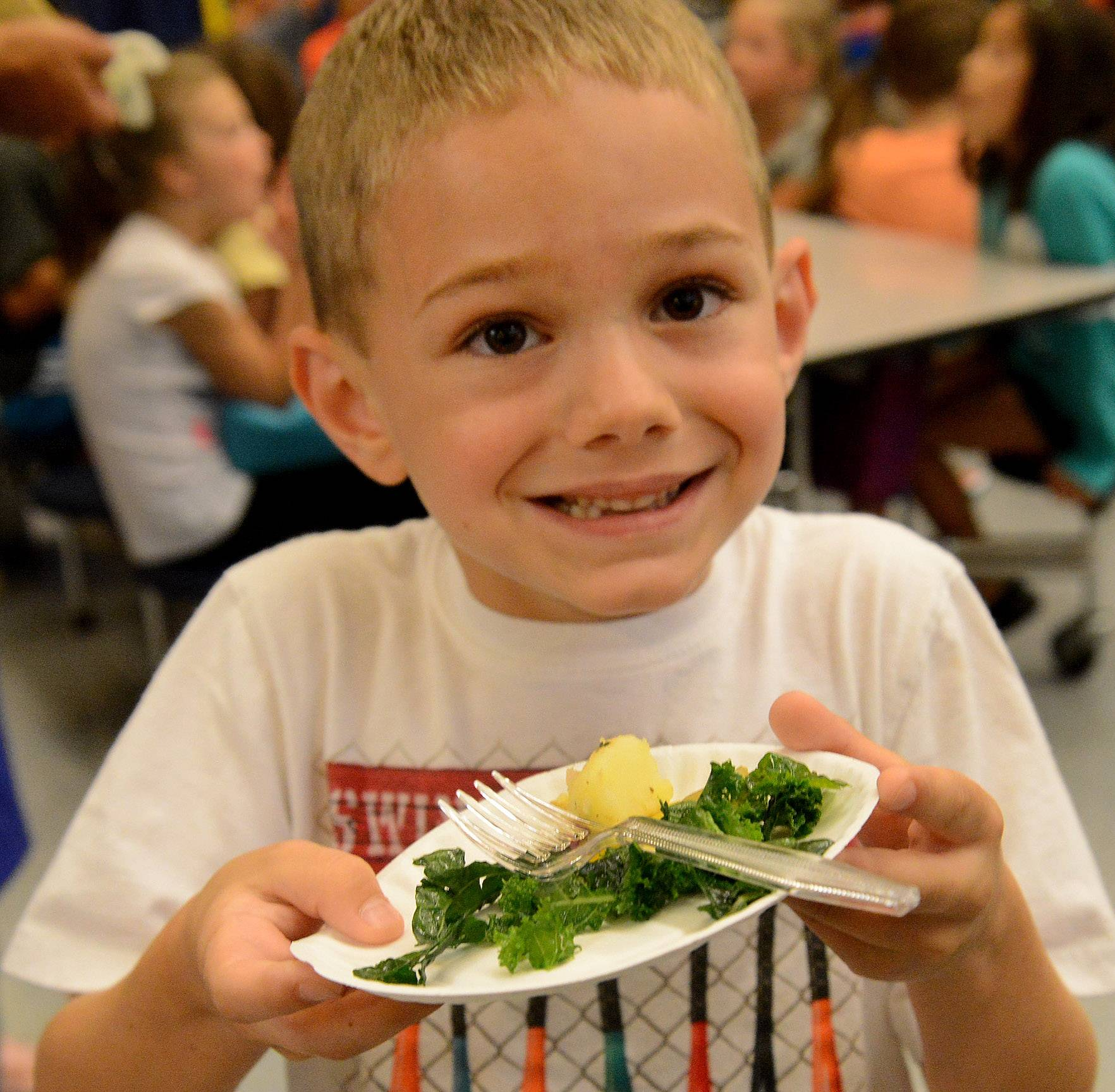 First-grader Cole Licato holds up his plate of kale, potatoes and beets salad during the fifth annual Windsor School Garden Tasting, featuring food from the school garden prepared by chef Tom Leavitt.