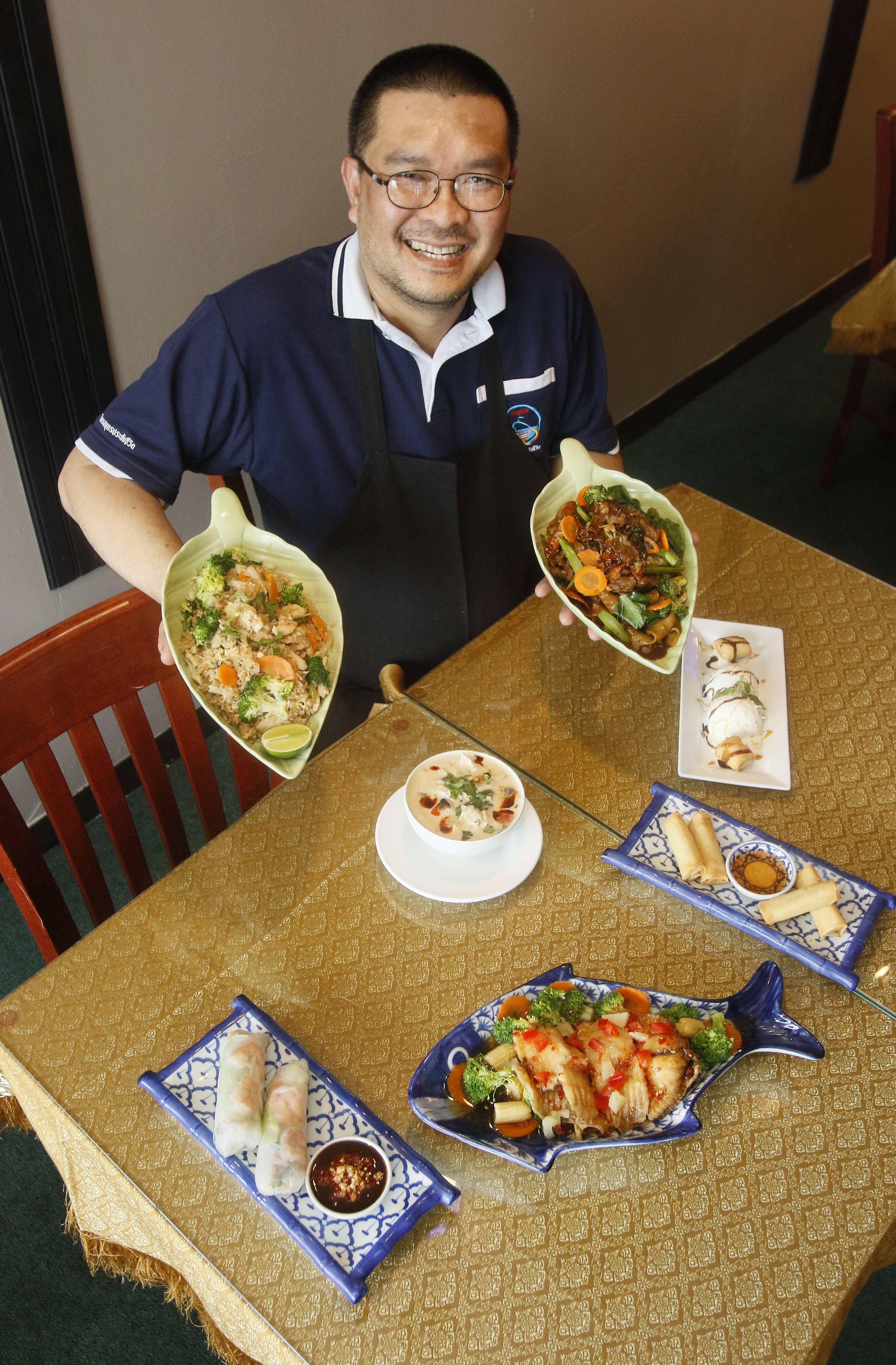 Chef Witoon Totom shows off a variety of dishes at Naperville's Khao Suay Thai restaurant.