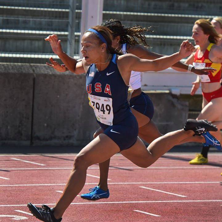 Hanover Park resident Emma McGowan crosses the finish line first in the 100-meter dash at the World Master's Track & Field Championships last month in Lyon, France.