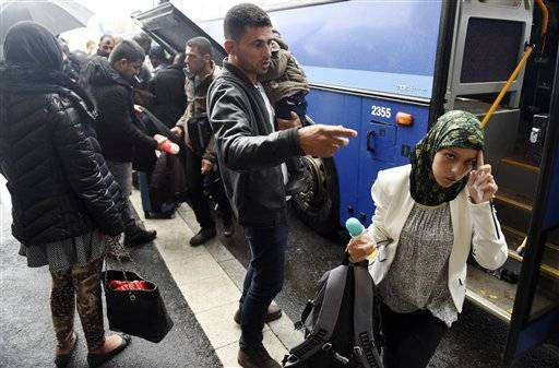 In this photo taken Thursday, Sept. 18, 2015, refugees arrive in Tornio, northwestern Finland. Finland, on the northeastern frontier of the EU with vast expanses of forests and reindeer roaming the wilds of Lapland, with long, dark, cold winters, has not been a prime destination for population flows in Europe, but now hundreds of people are crossing daily from neighboring Sweden after traveling through that country by train or bus. (Jussi Nukari/Lehtikuva via AP) FINLAND OUT, NO SALES
