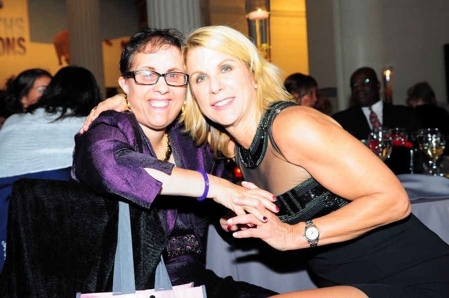 Little City participant Andrea Bell poses with her sister Julie Bell at Little City's annual dinner gala fundraiser at Chicago's Field Museum on Sept. 26.