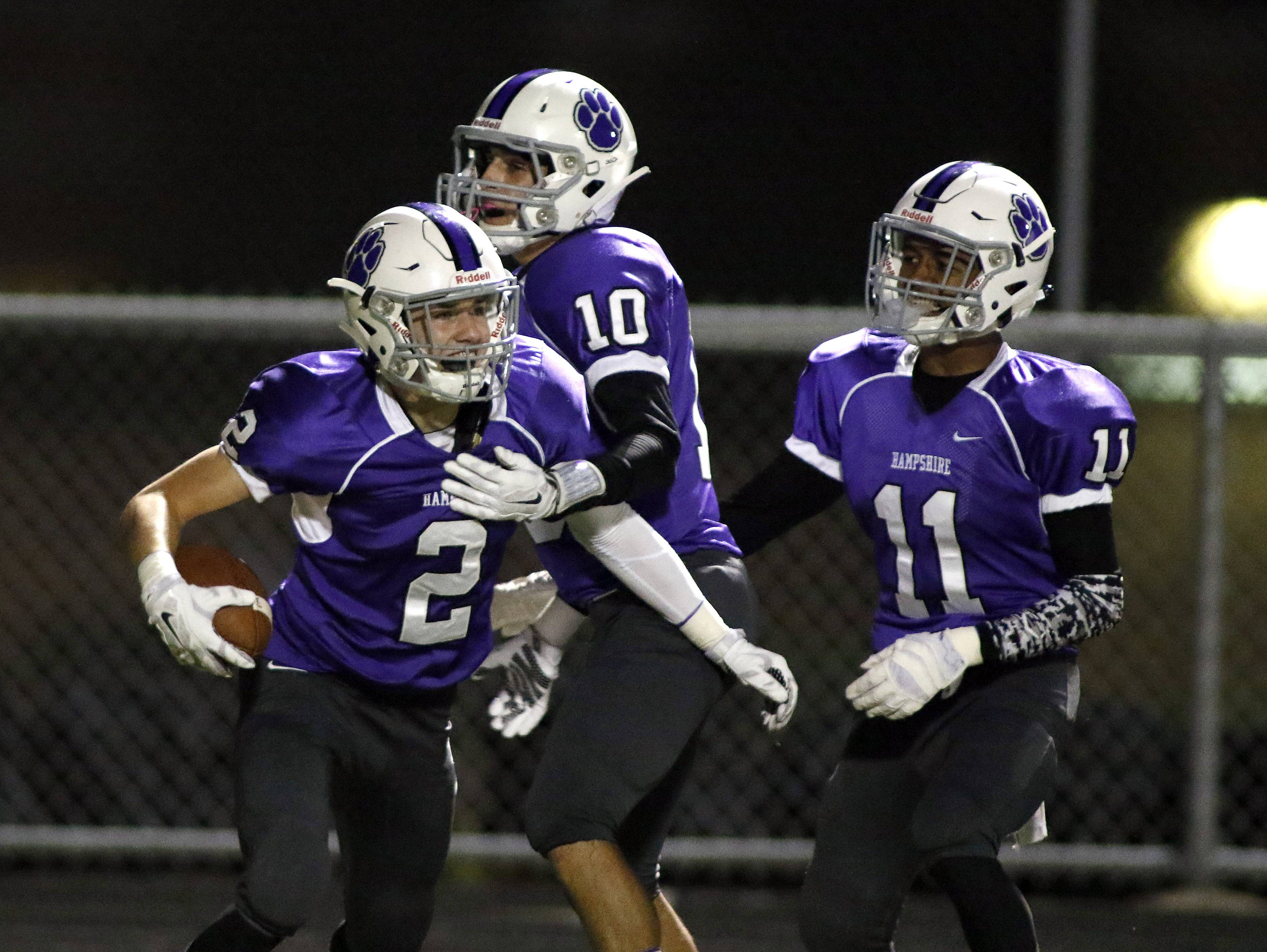 Hampshire's Jake Manning, No. 2, celebrates his touchdown against Grayslake Central with teammates Connor Burke, No. 10, and Xavier Bennett, No. 11.